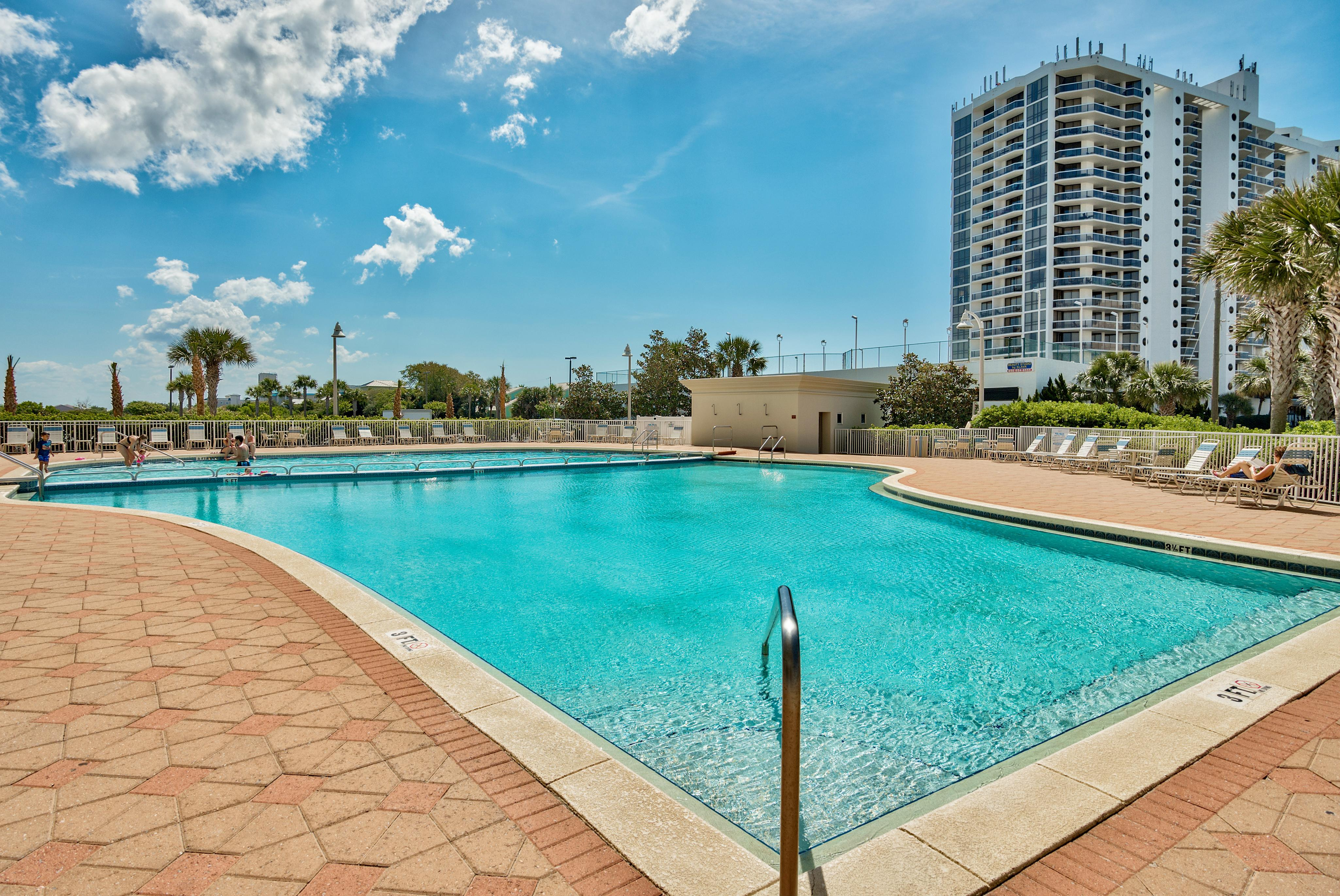 Your reservation at the Ariel Dunes II condo complex includes access to shared amenities including a pool, hot tub, gym, and grilling area.