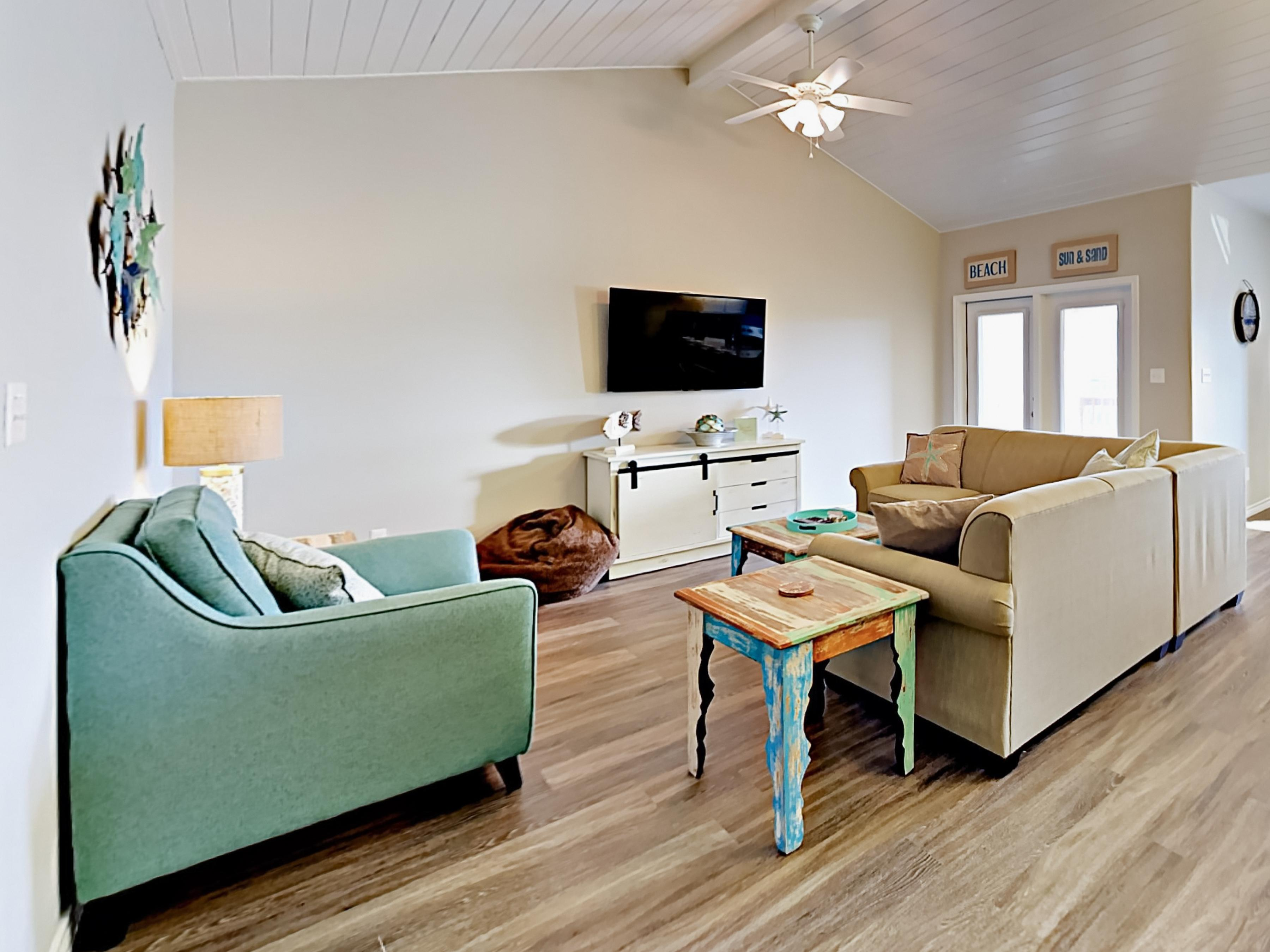 "Welcome to Port Aransas! Host movie night in the living room, which offers a 55"" flat screen TV."