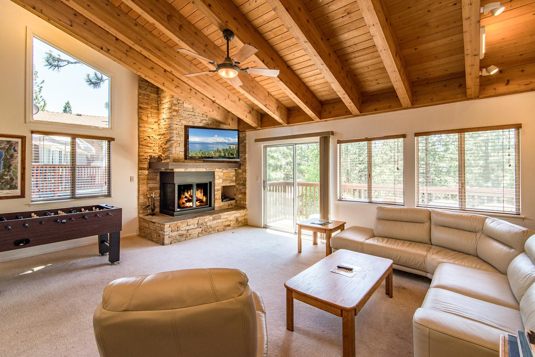 A gas fireplace, comfortable seating and flat screen TV adorn the living room