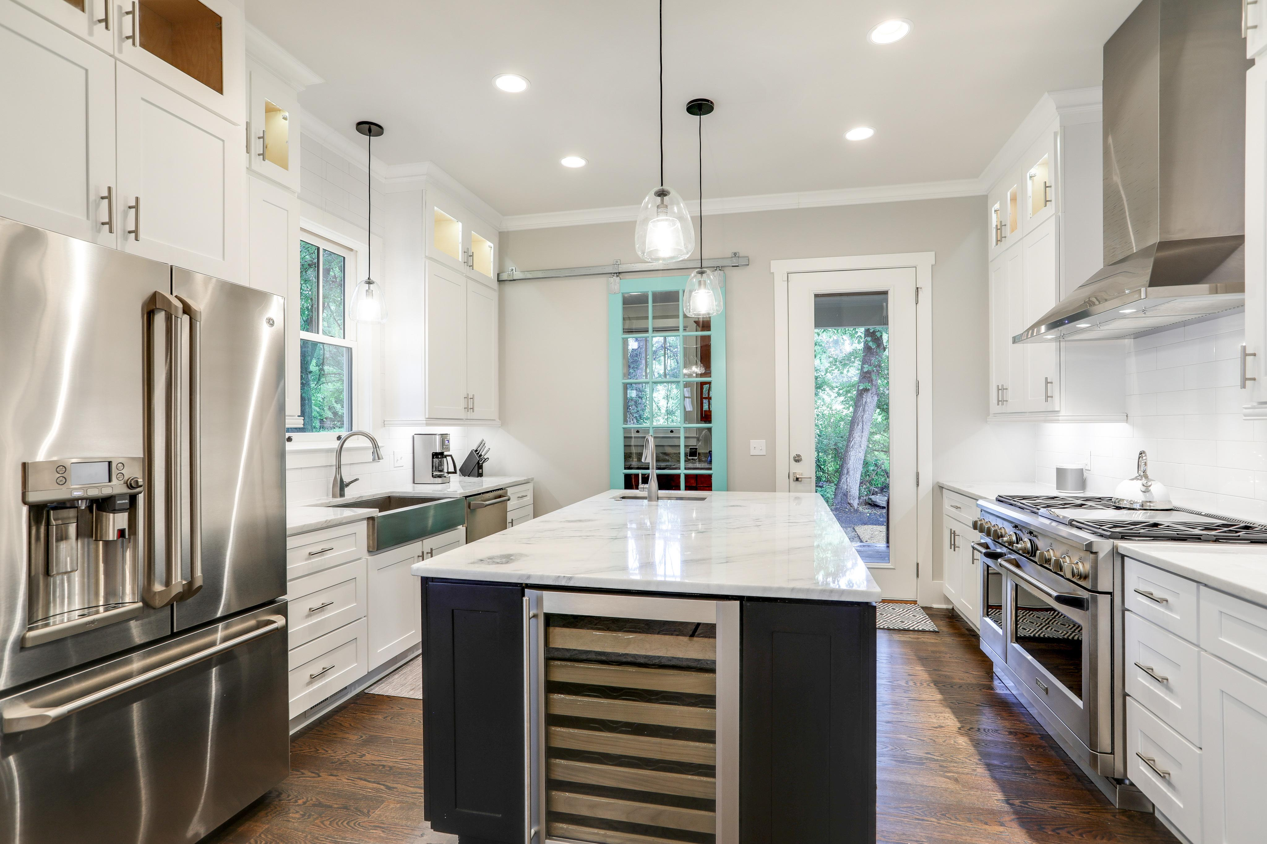Modern appliances adorn the kitchen.