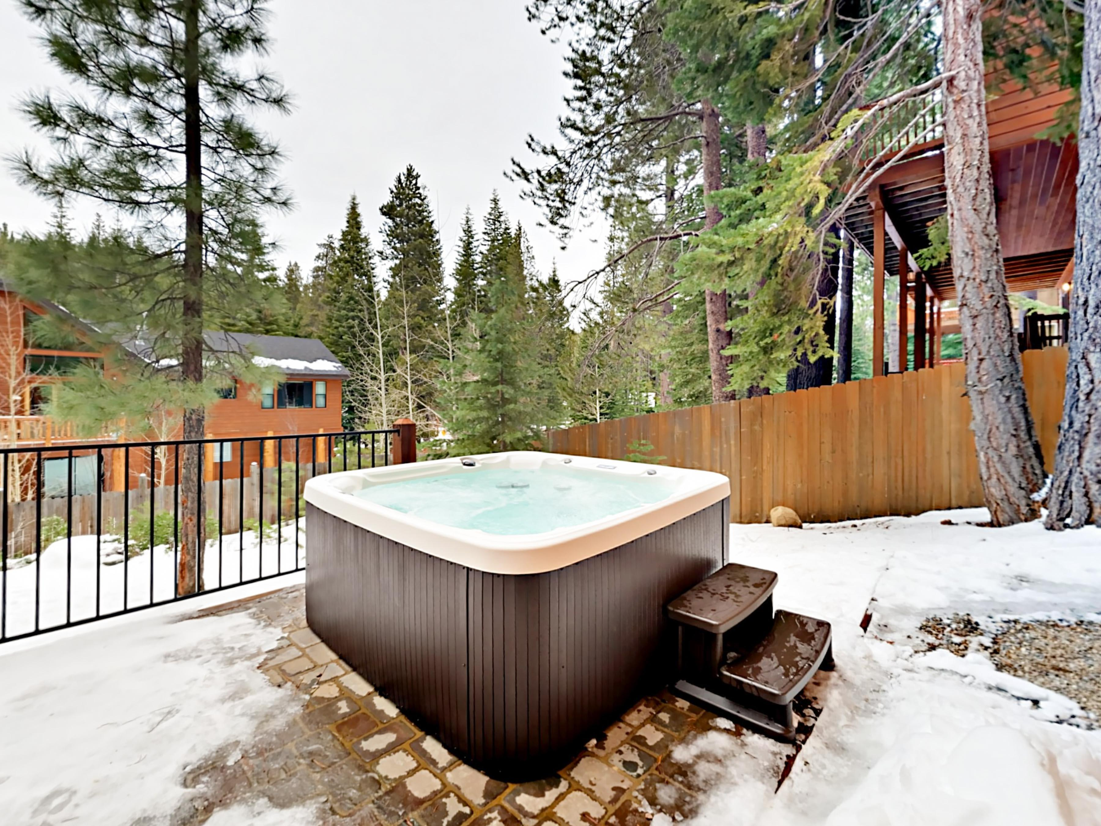Soak in the private hot tub after a fun day exploring the mountain.