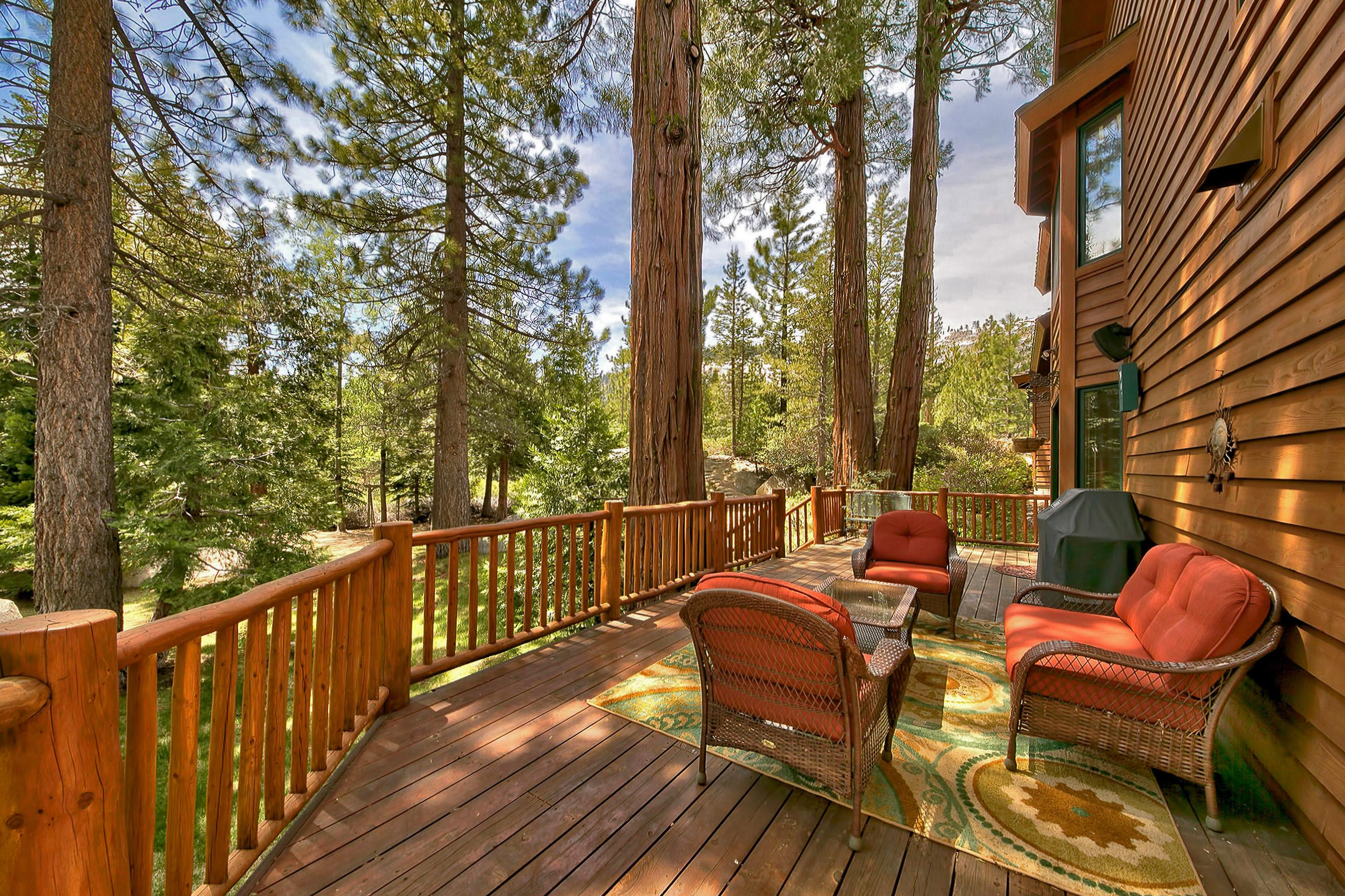 Entertain on the expansive furnished deck with wooded views.