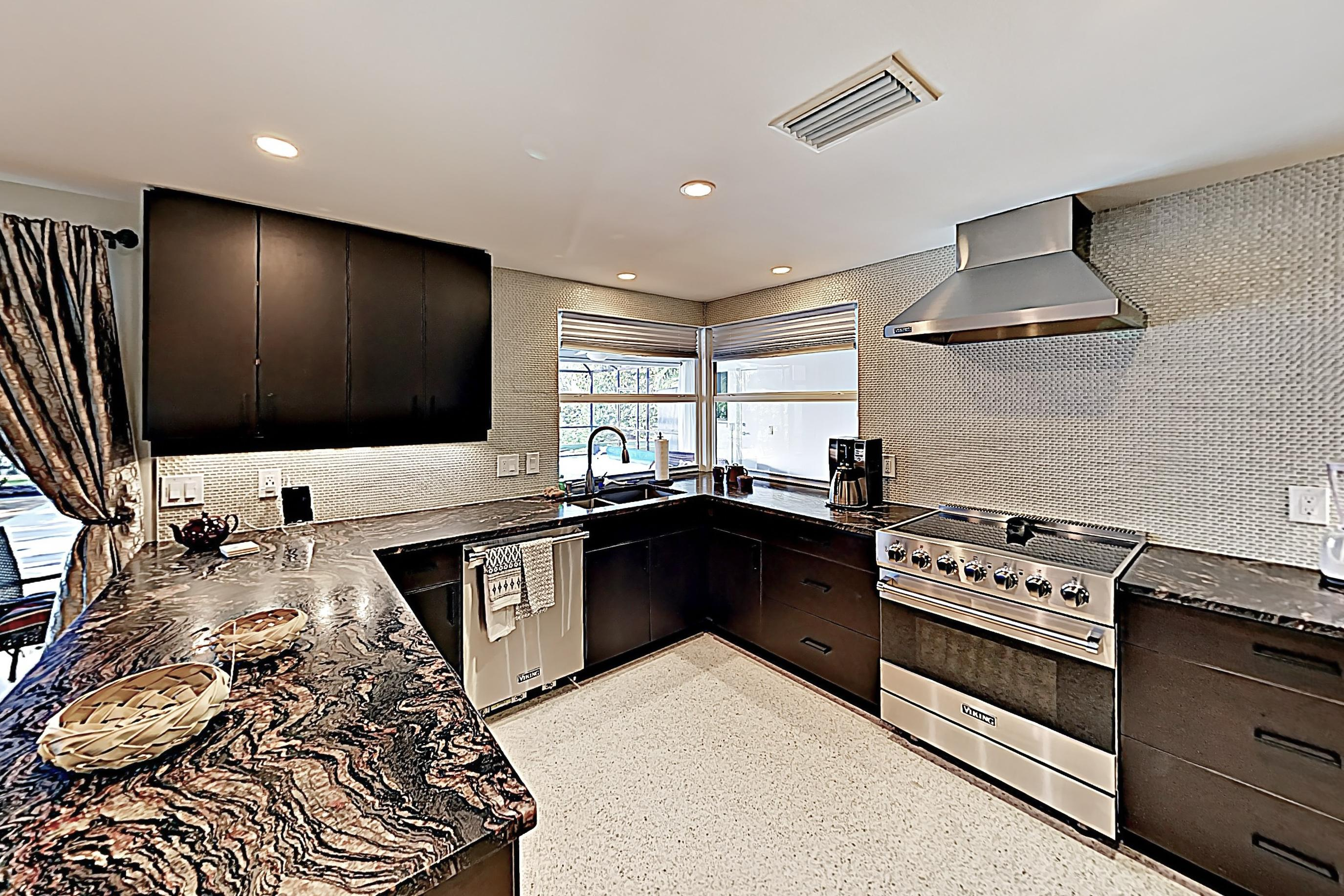 The chef's kitchen boats granite countertops and stainless steel Viking appliances.