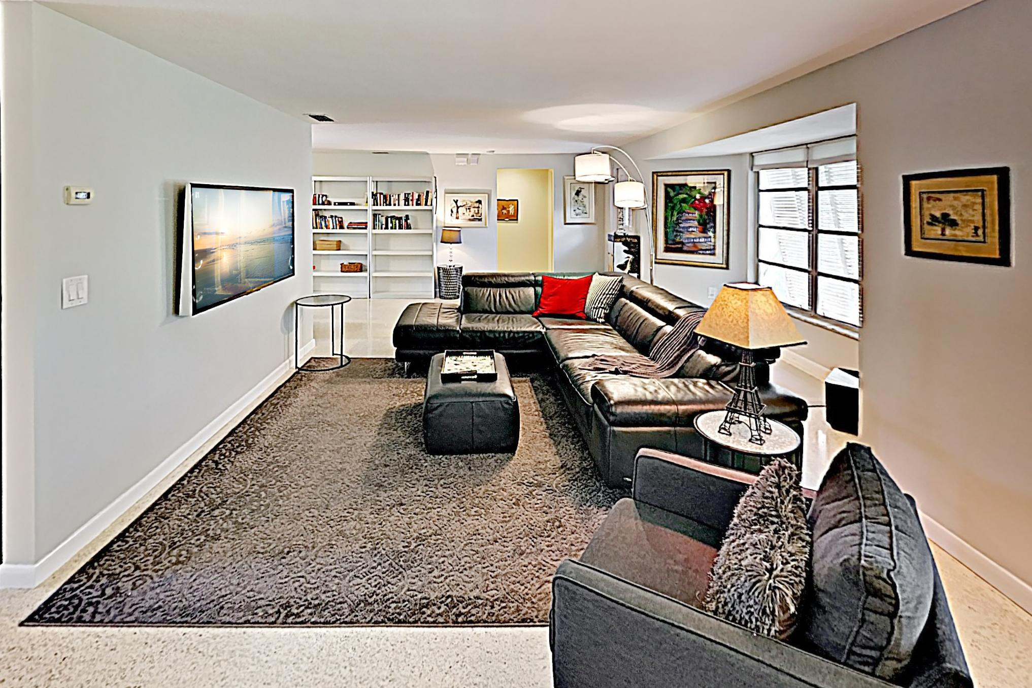 Kick back and relax on the leather sectional in the living room.