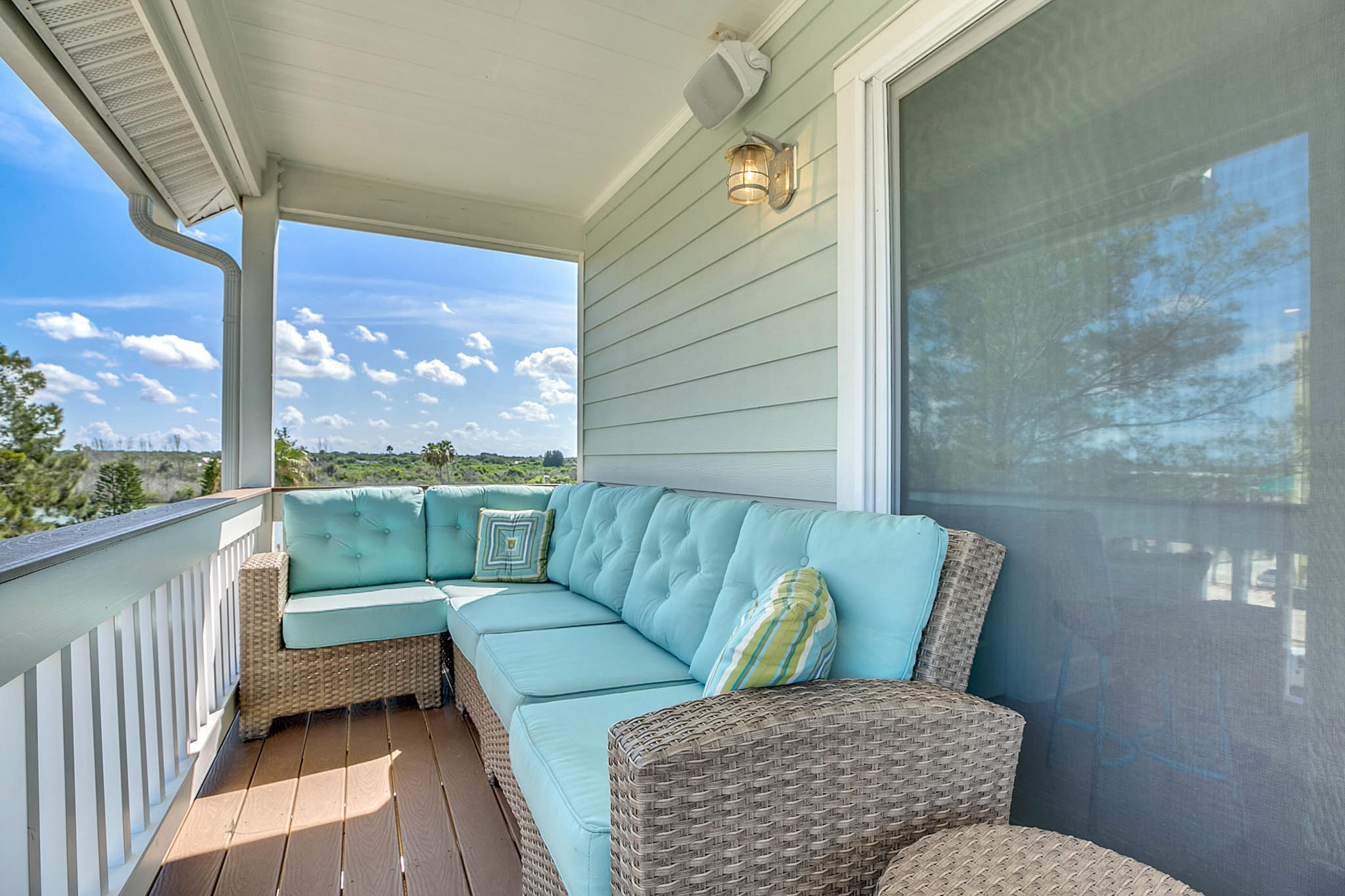 Sink into the sectional and breathe fresh air on your private balcony.