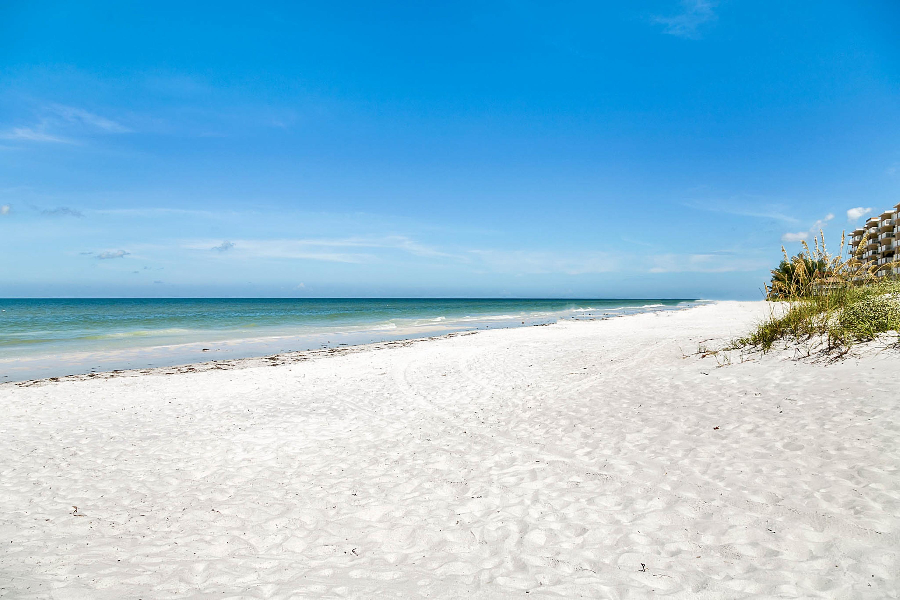 Walk to the private white-sand beach.