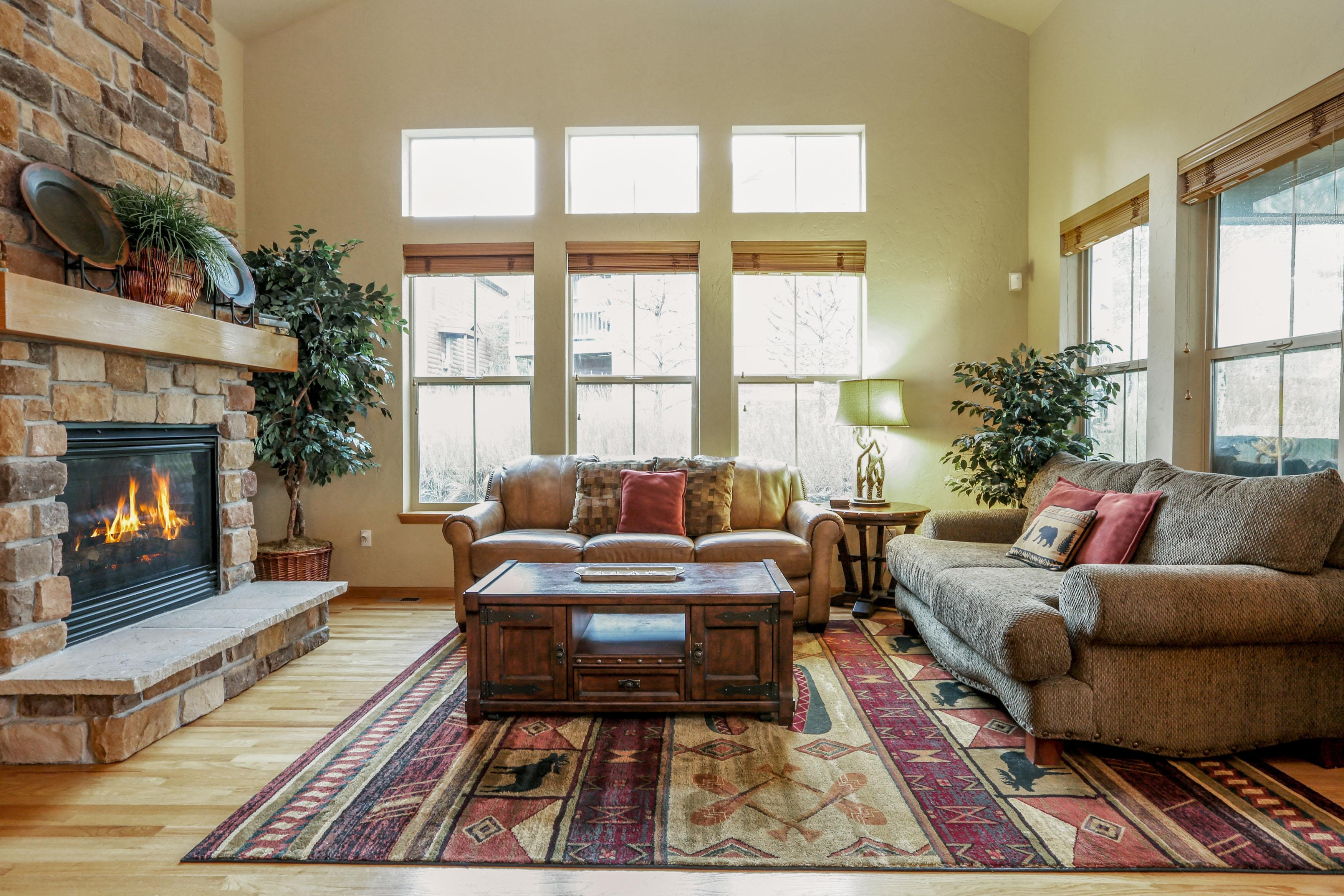 Welcome to your Granby vacation rental! Relax in your living area complete with a stone fireplace, vaulted ceilings, sleeper sofa, and love seat.