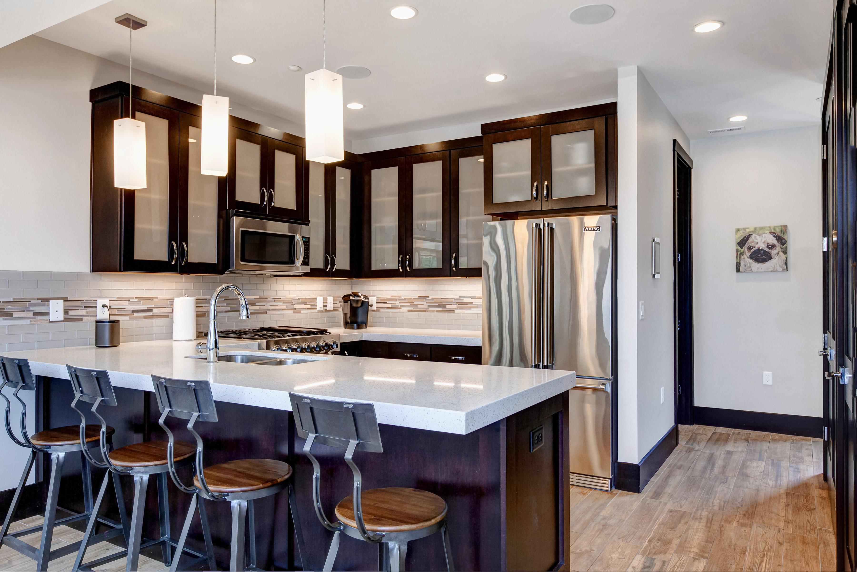 Modern kitchen with stainless appliances and counter seating for 4.
