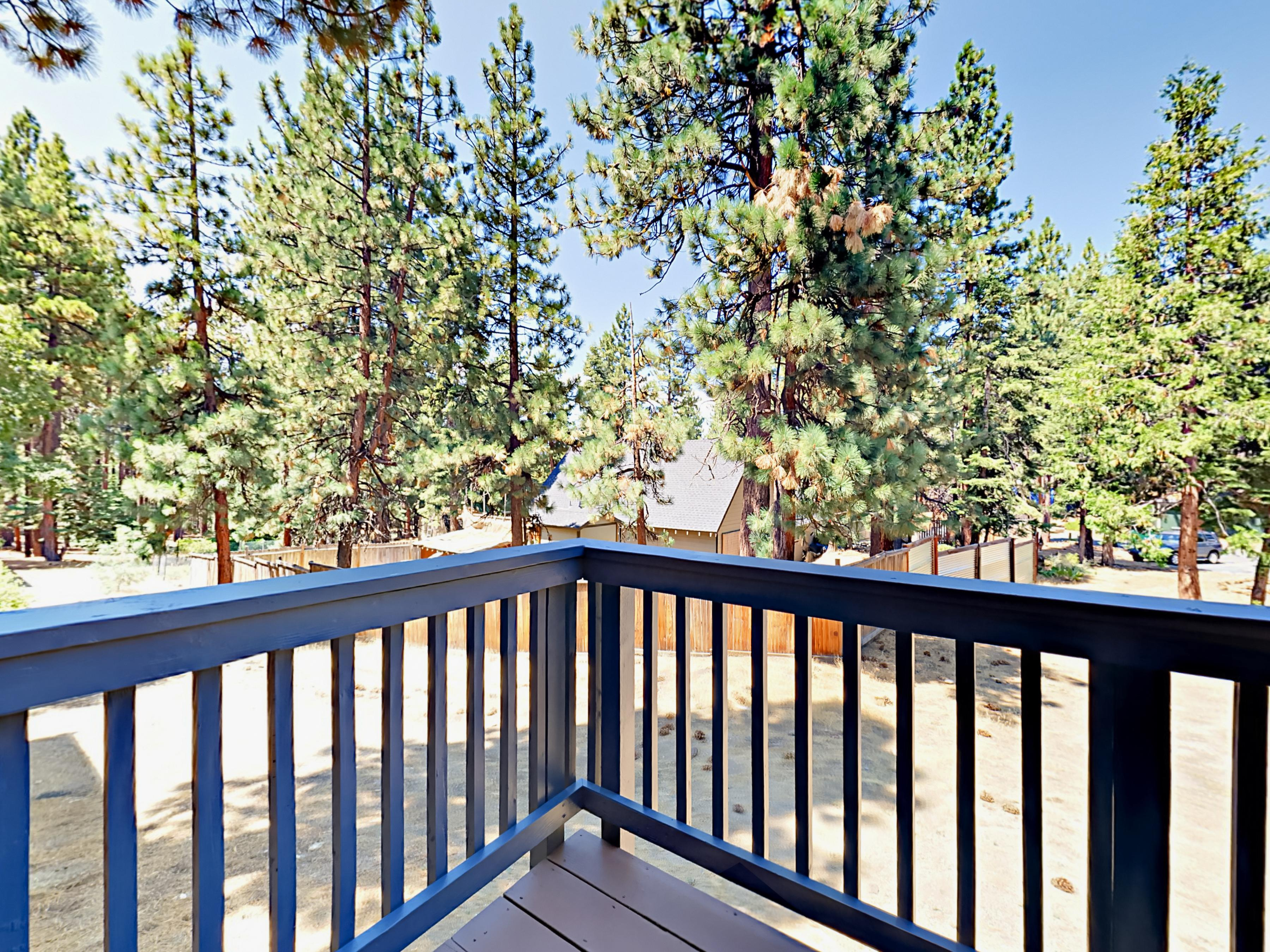 Alpine views from the balcony with outdoor bistro dining set, Char-Broil 4-Burner gas grill.
