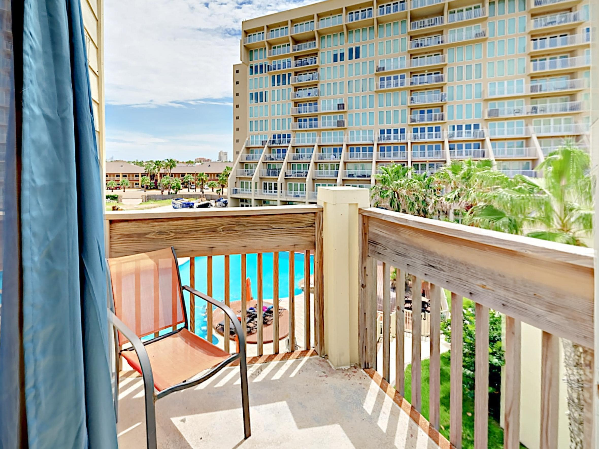 Your private balcony overlooks the shared pool and hot tub.