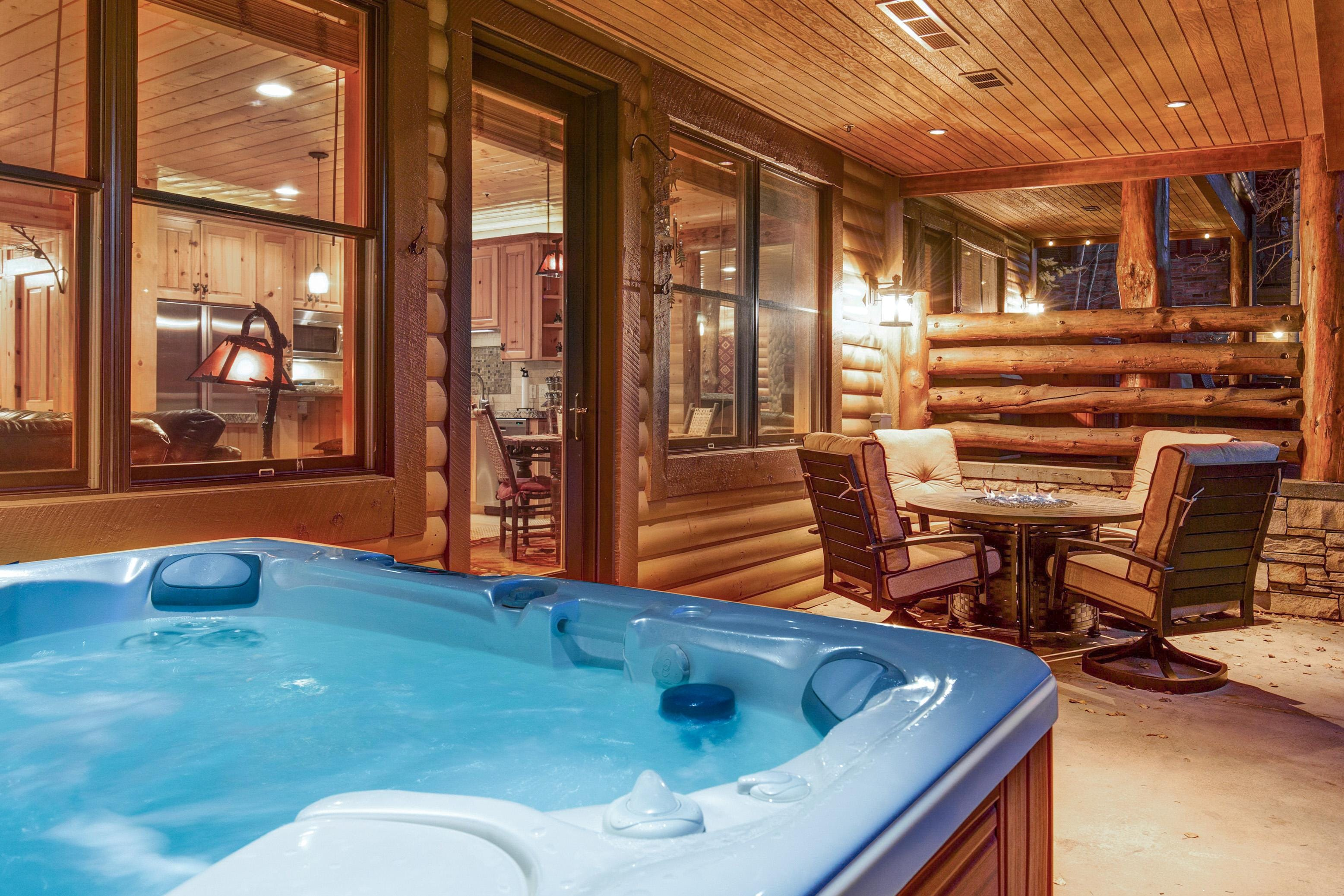 Slip into the hot tub on the back patio for ultimate relaxation.
