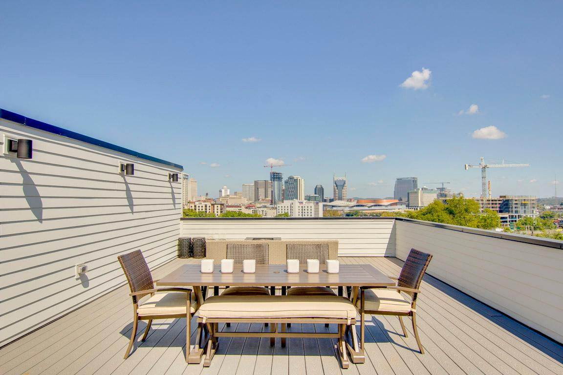 The expansive rooftop deck boasts seating for 7 around the fire pit, and an outdoor dining seating 6.