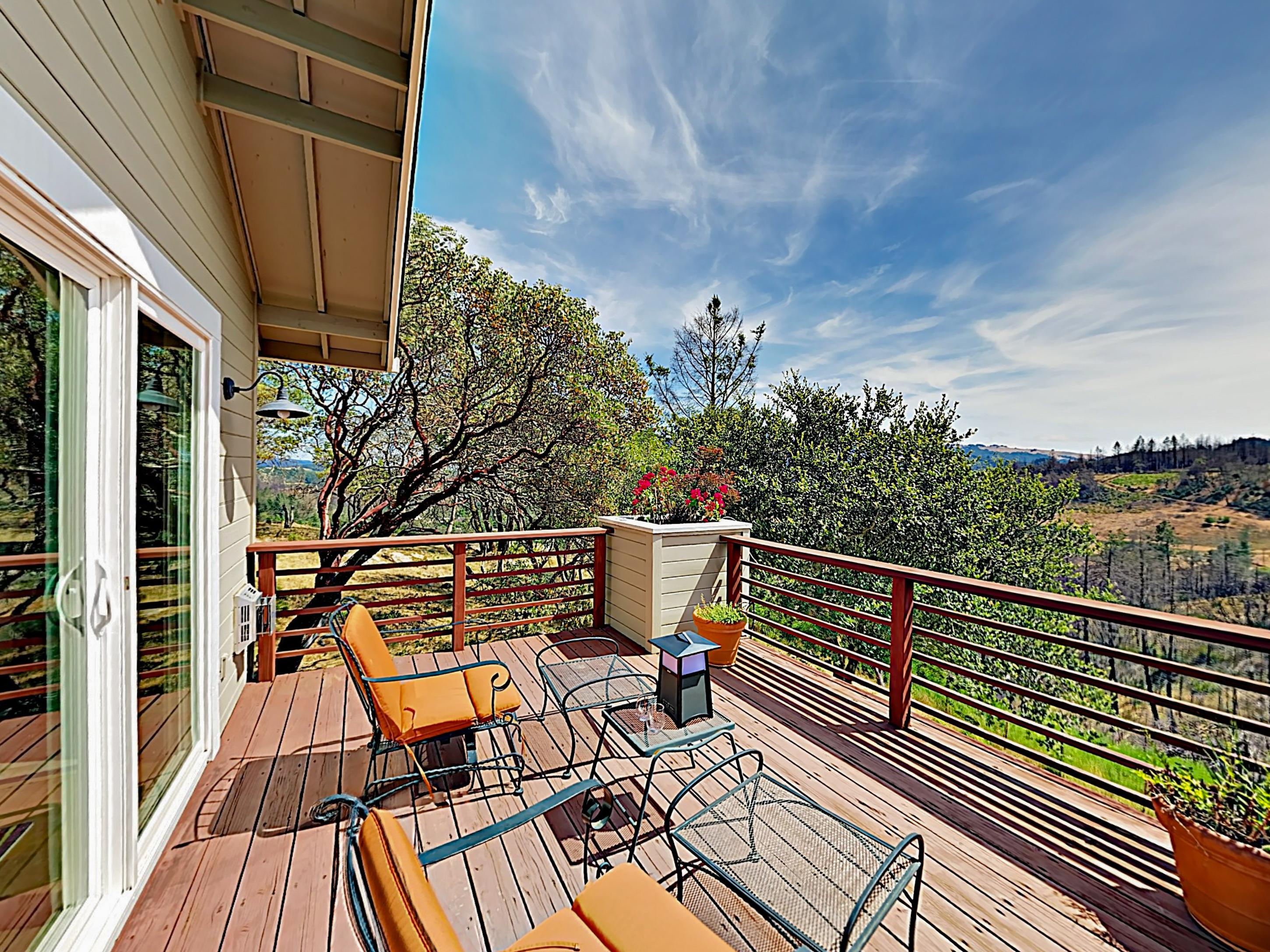 The private cottage deck provides ample mountain views.