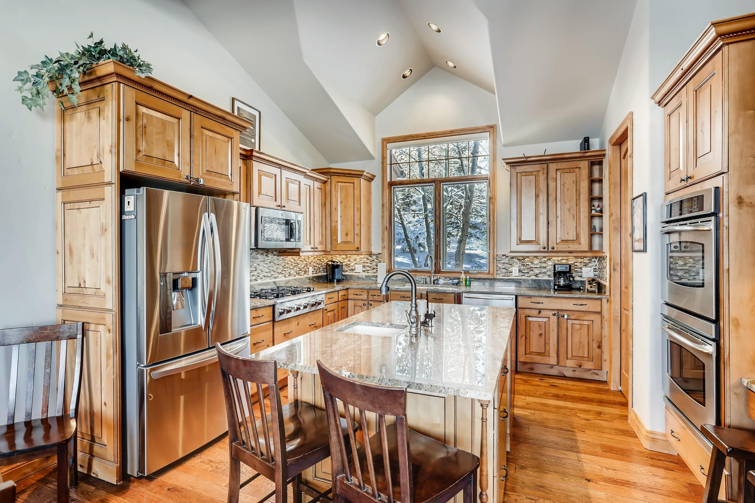 The deluxe gourmet kitchen has a large island with an additional sink and seating for 2.