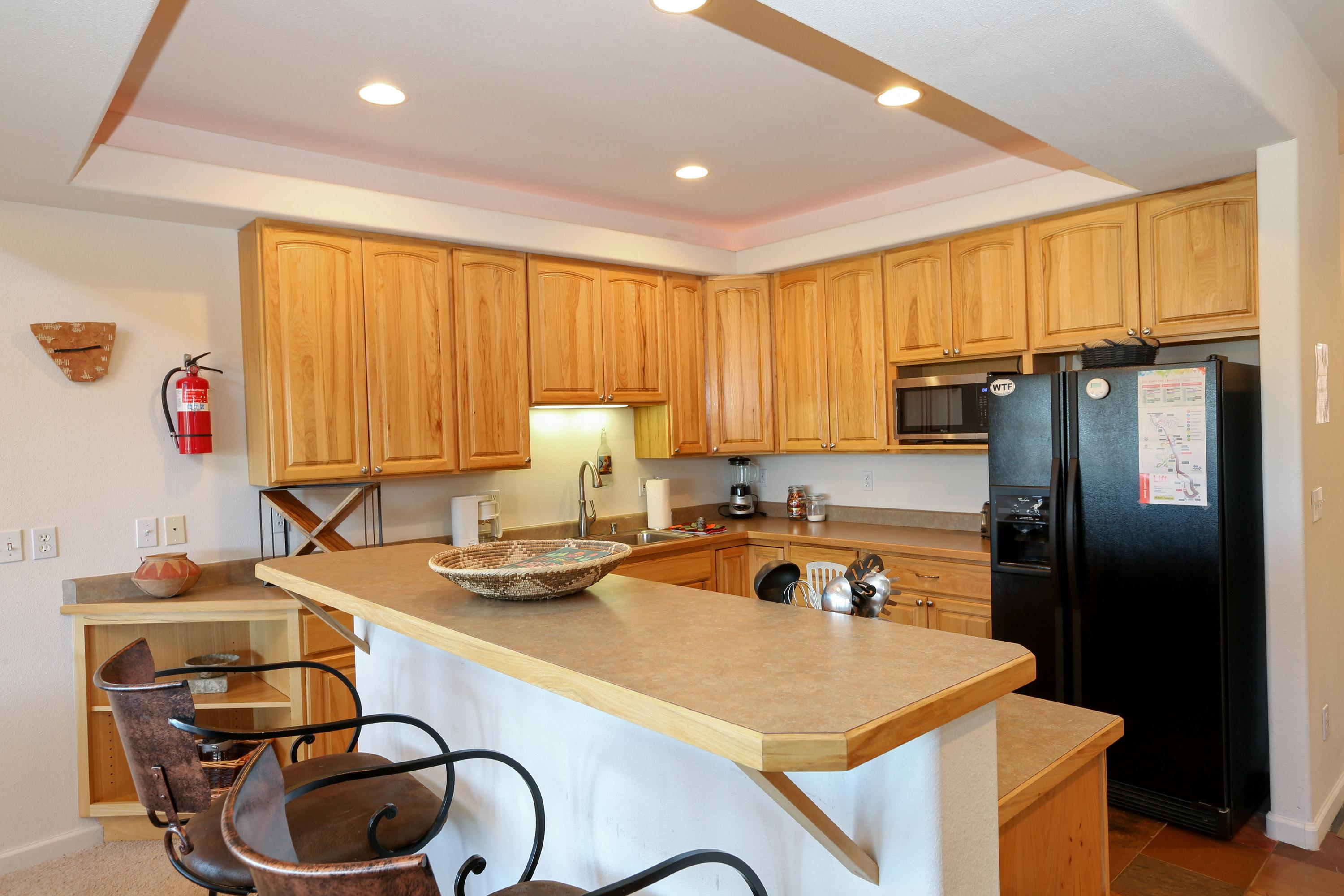 The well-equipped kitchen has everything needed to put together full meals. Along with high-end appliances, you'll find handy extras like a toaster, coffeemaker, and blender.
