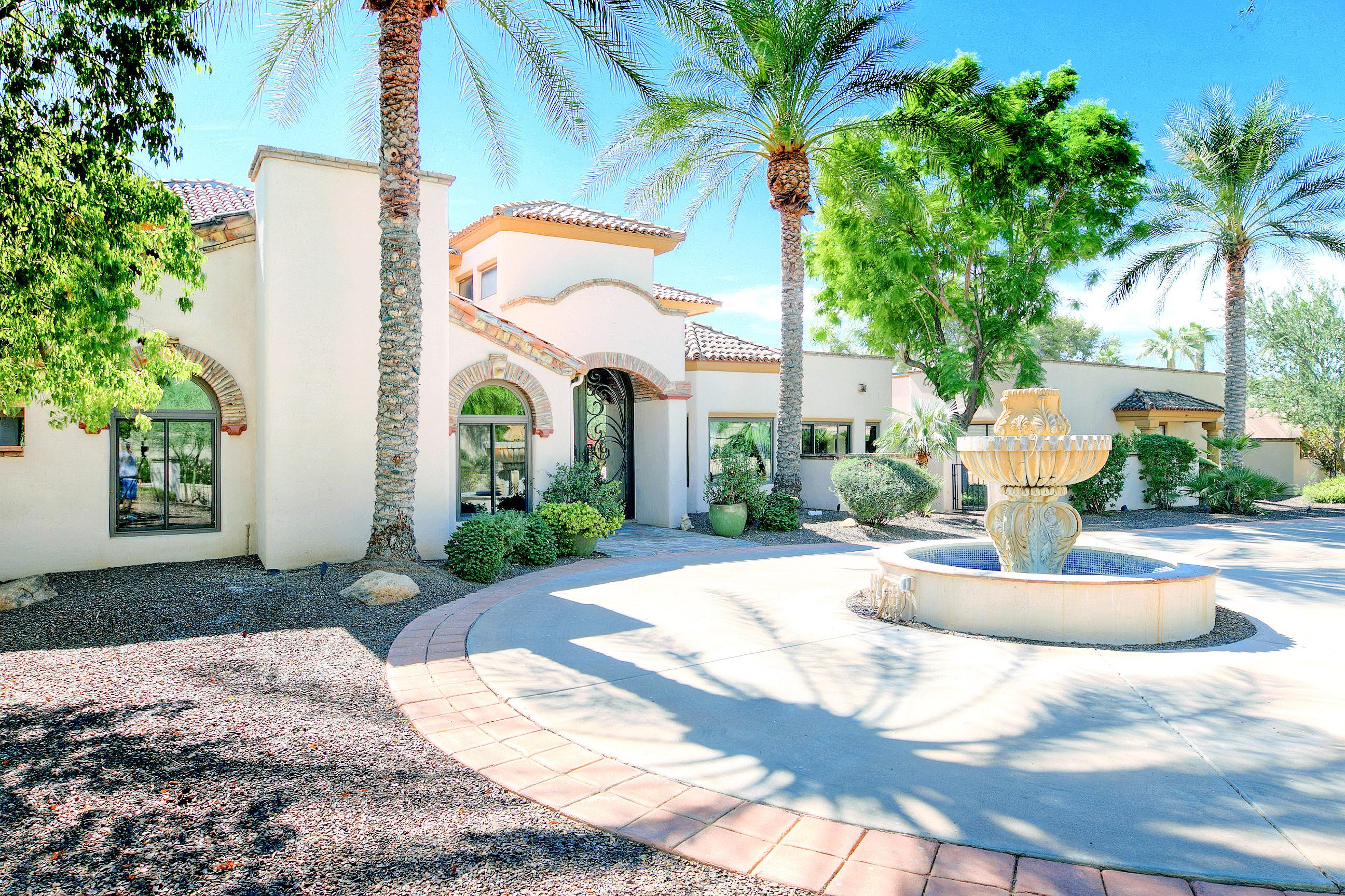 Welcome to Paradise Valley, where a tropically landscaped courtyard greets you upon arrival.