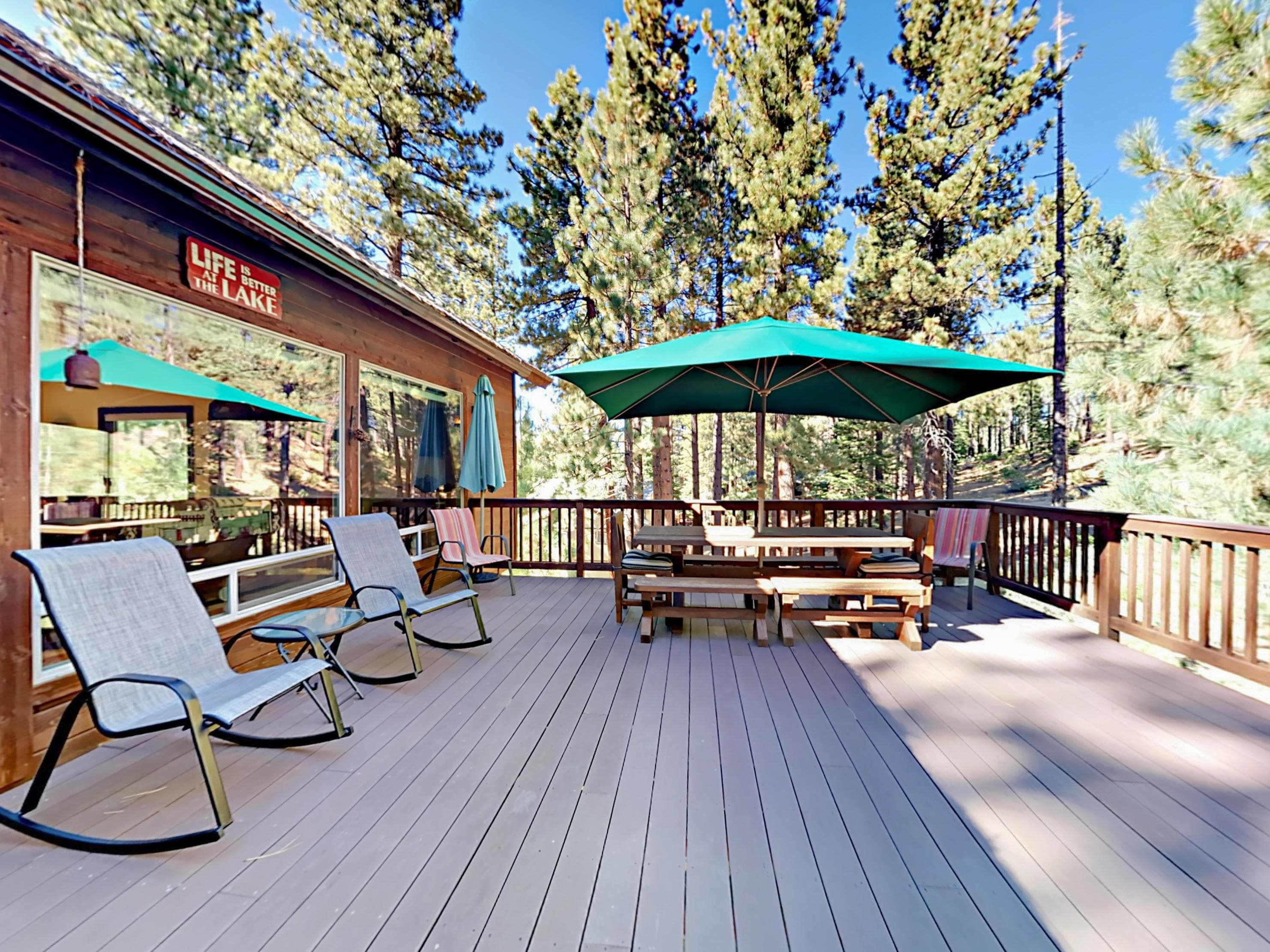 A spacious deck overlooks the soaring pines.