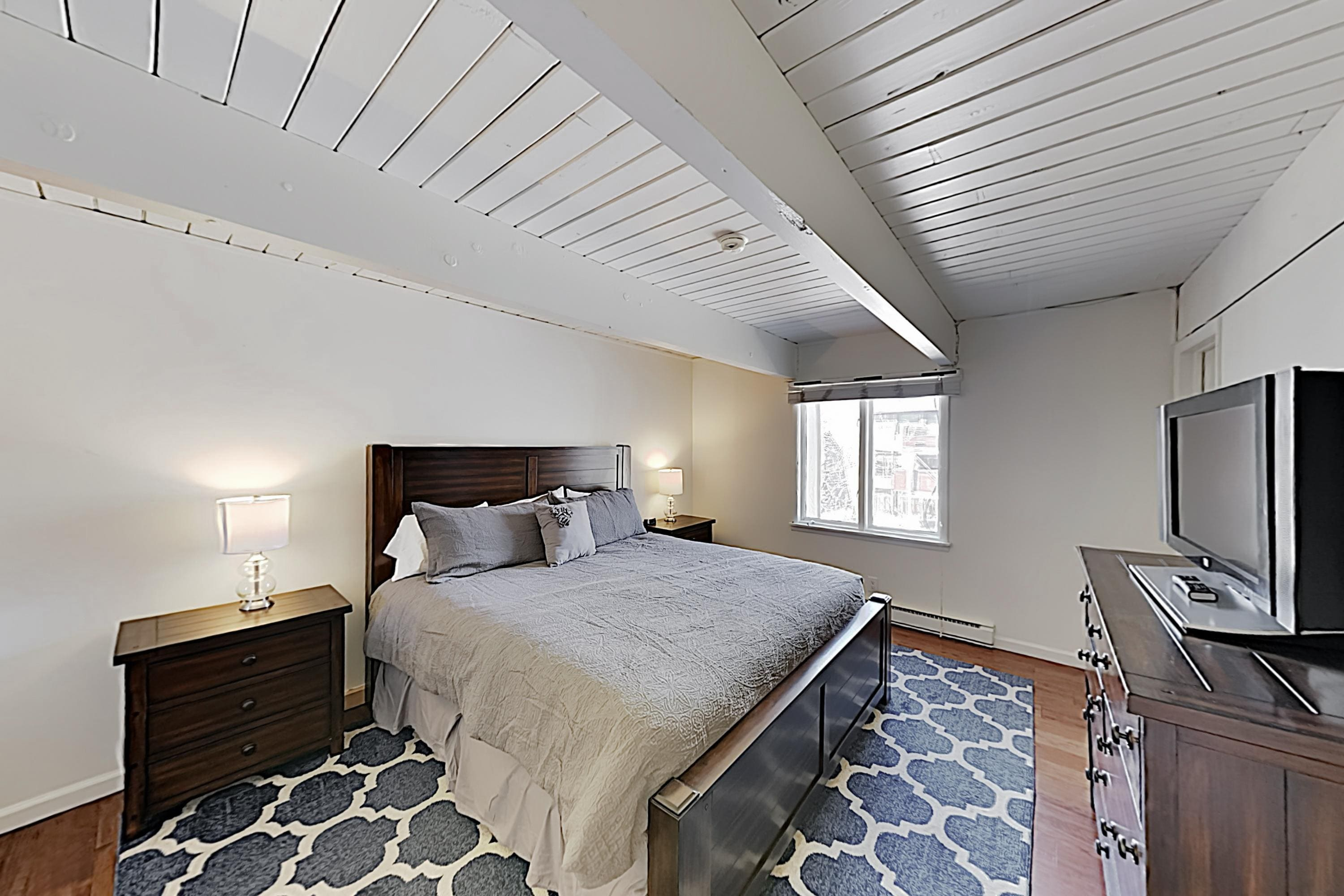Stretch out on a king bed in the master bedroom.