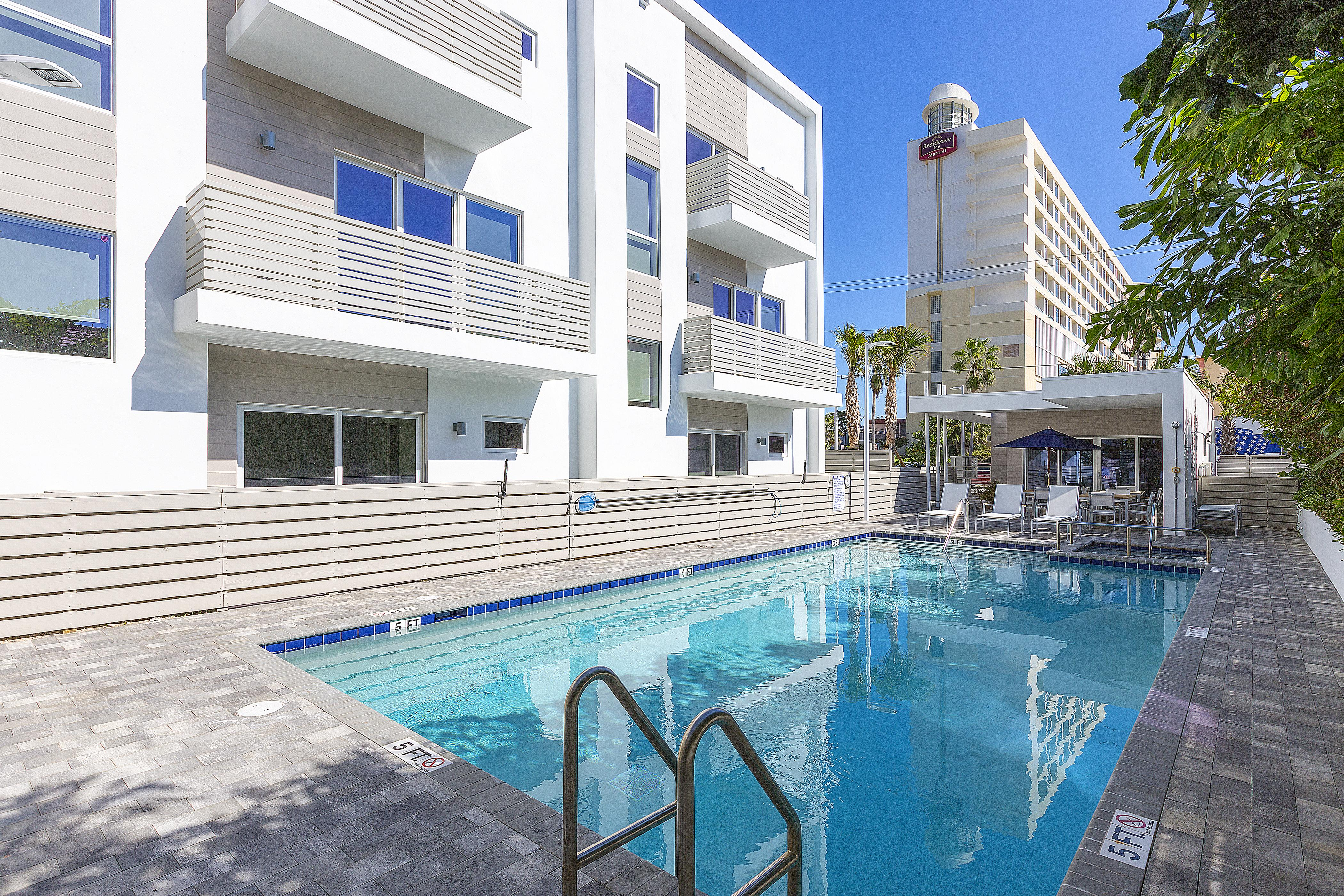 Enjoy relaxing by the shared pool and sundeck with hot tub.
