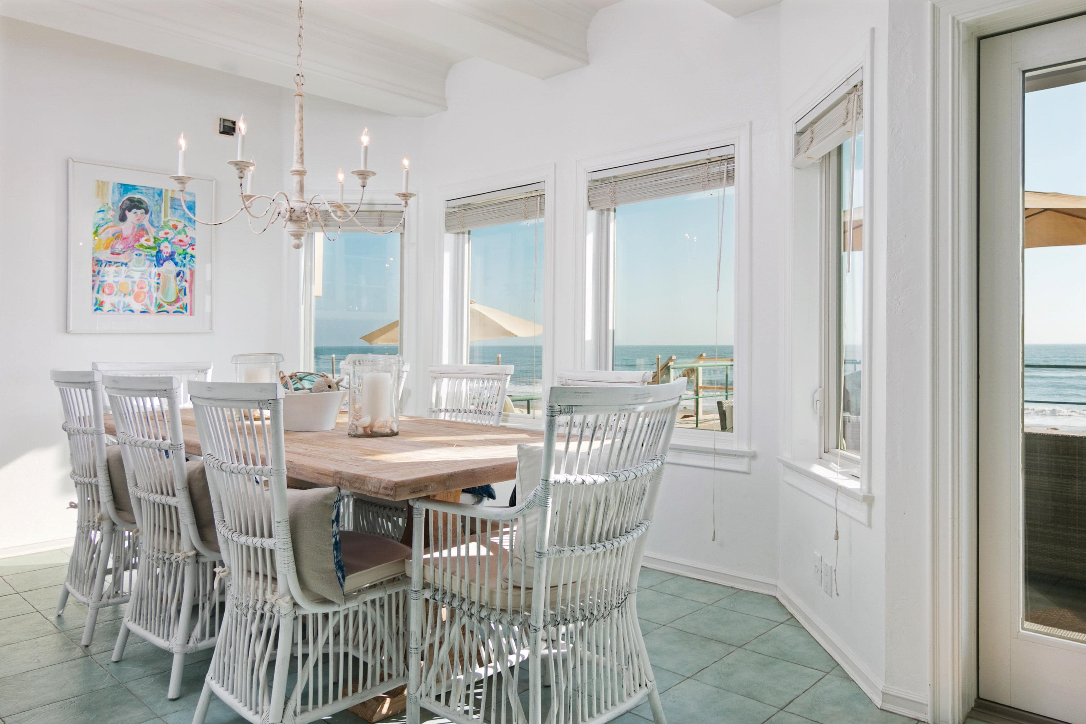 The dining area offers seating for 8 with spectacular beach views.