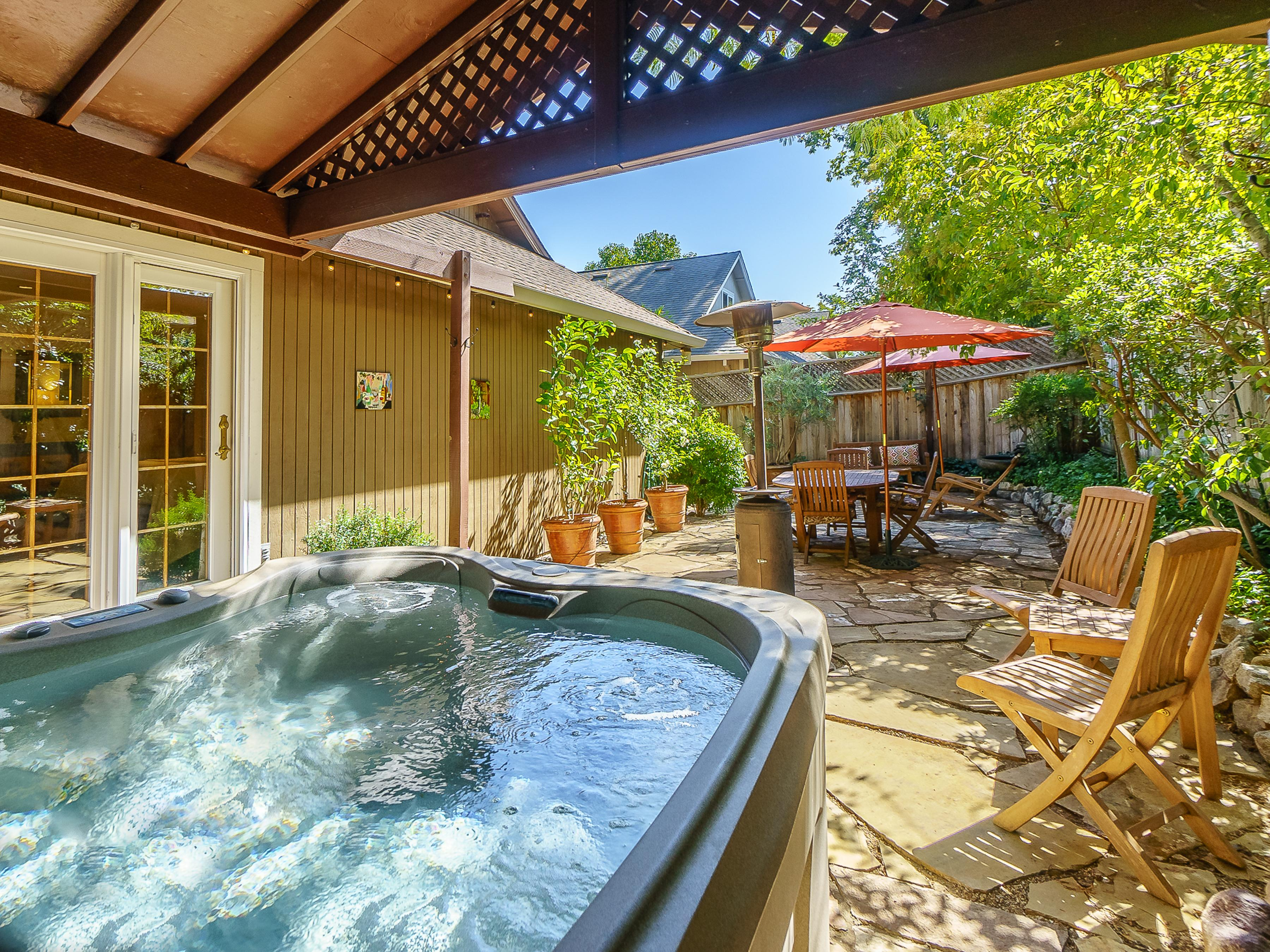 Enjoy a relaxing soak in the covered hot tub. Your rental is professionally managed by TurnKey Vacation Rentals.