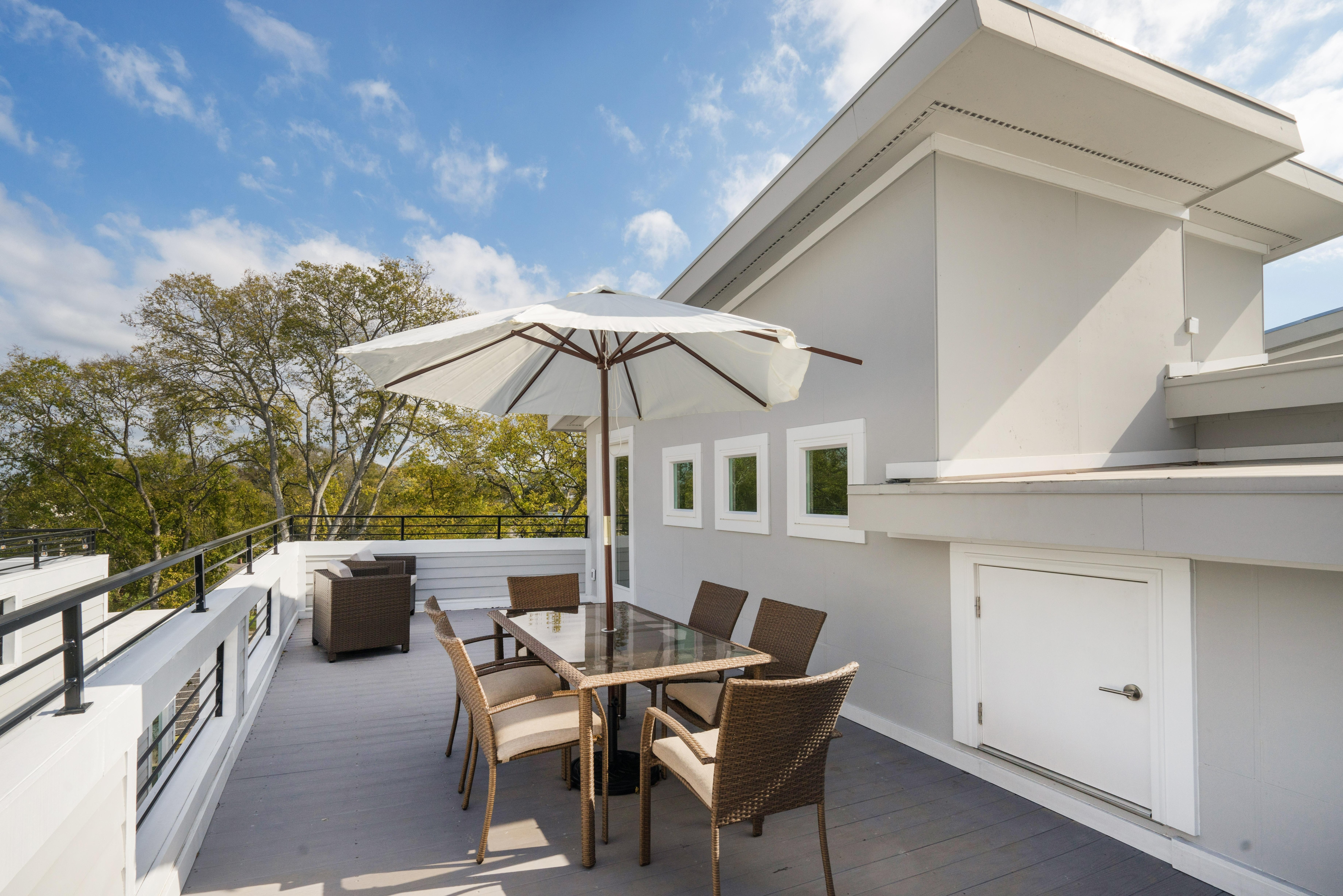 A private rooftop deck takes outdoor living to another level-- complete with expansive tree-top views.