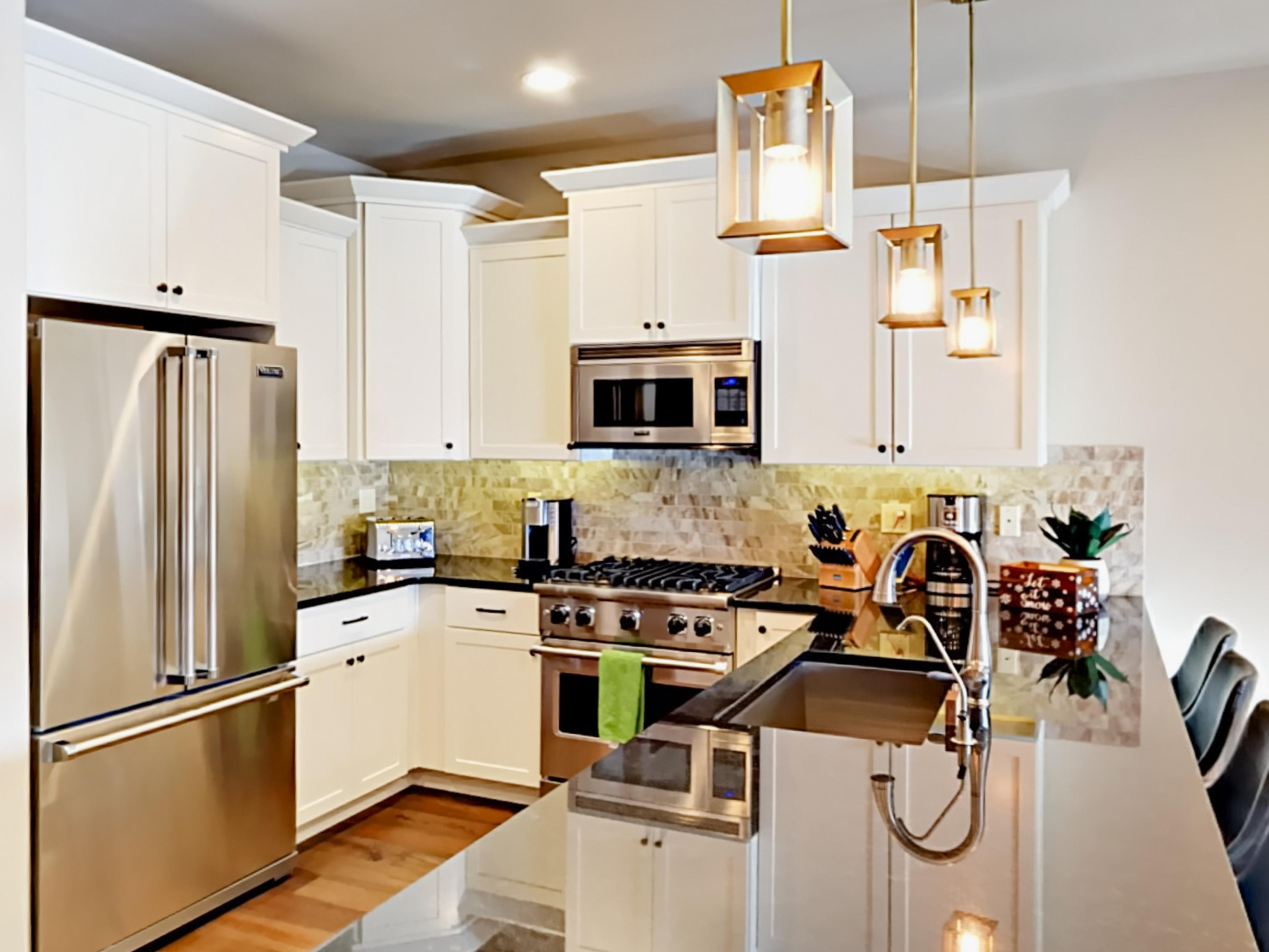 All the essentials can be found in the fully-equipped kitchen with stainless steel Viking appliances and granite countertops.