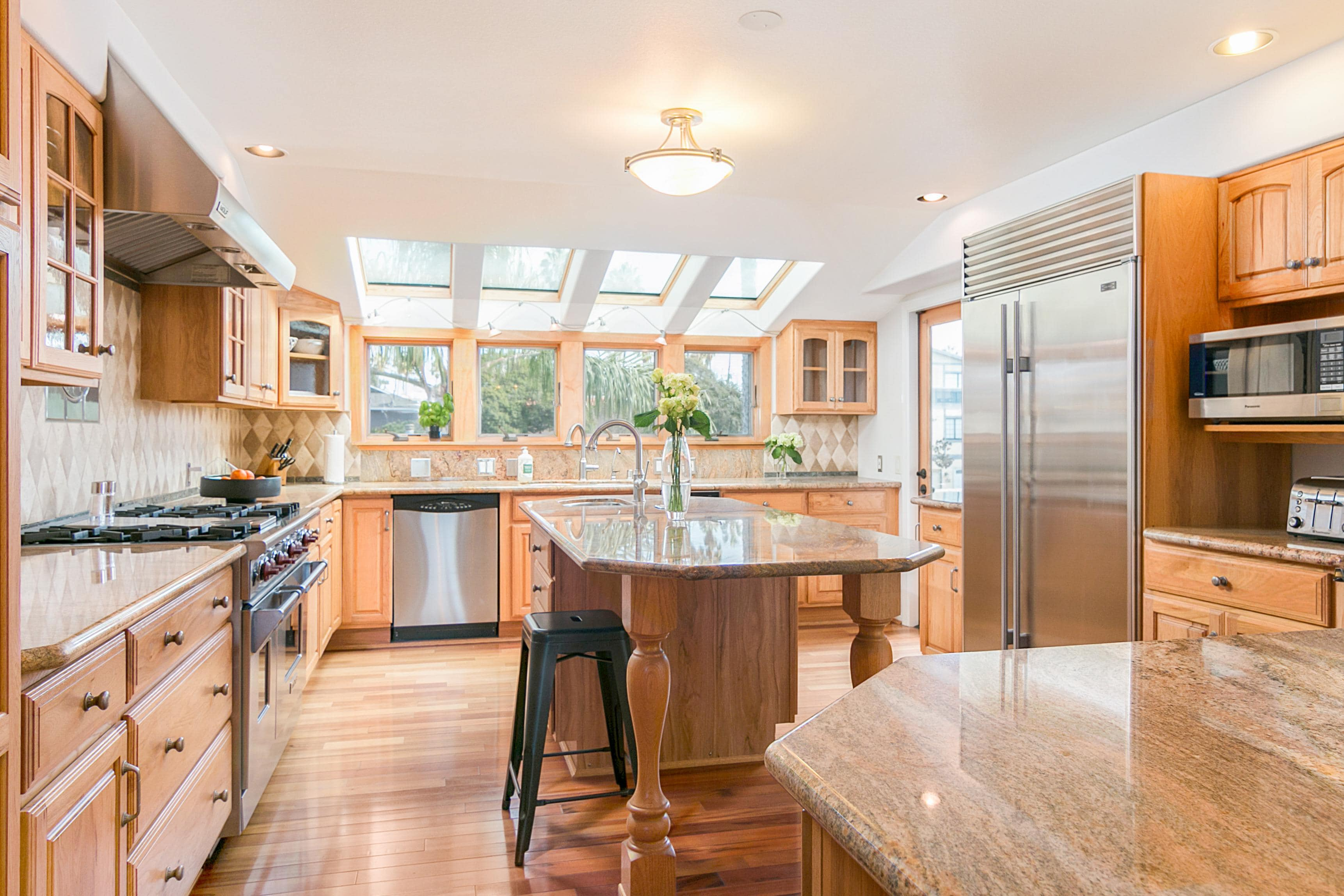 Welcome to Ventura! Gleaming stainless steel appliances and granite countertops in the gourmet kitchen.