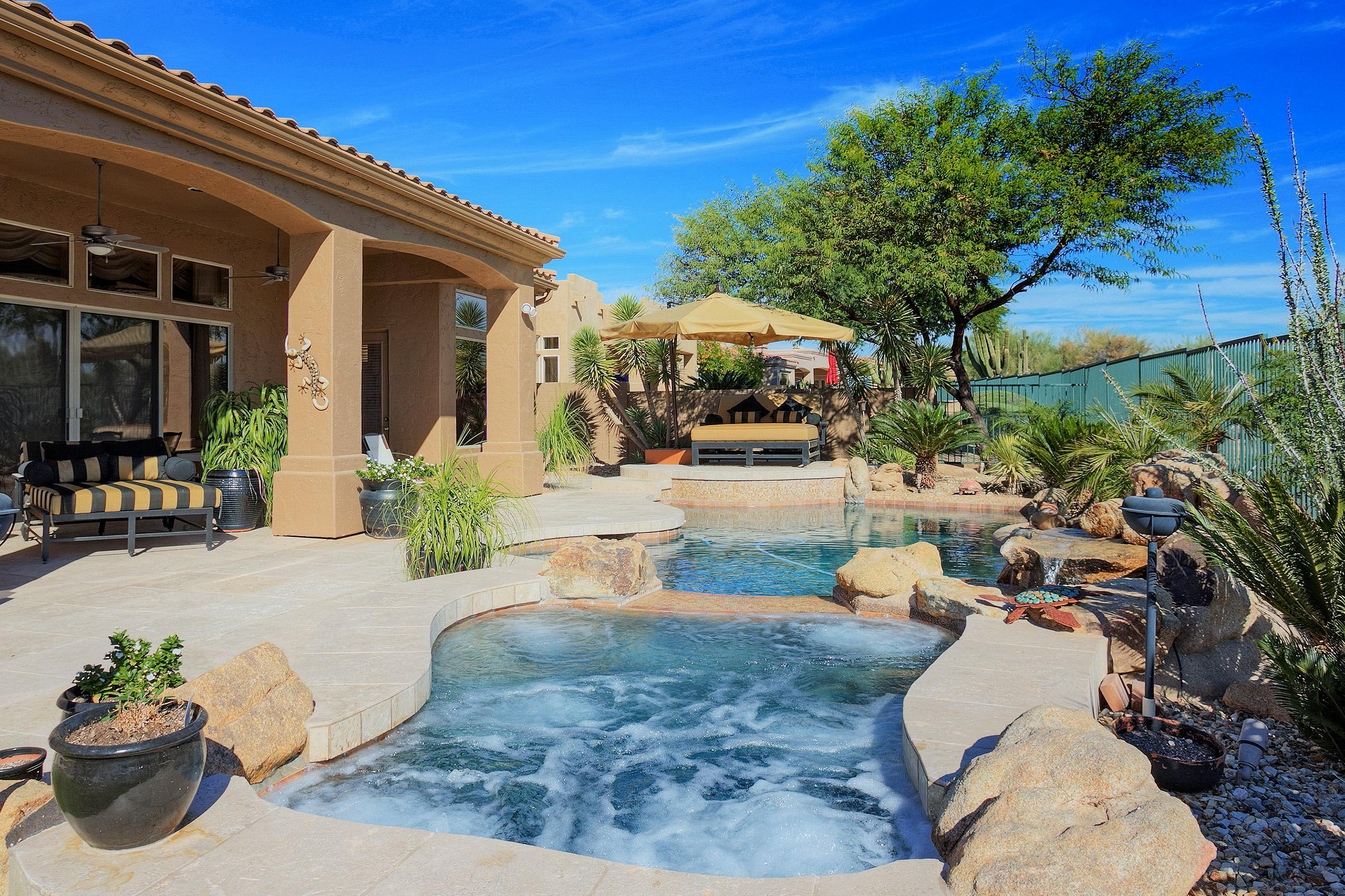Welcome to Scottsdale! Enjoy endless views from this salt water pool with attached hot tub.