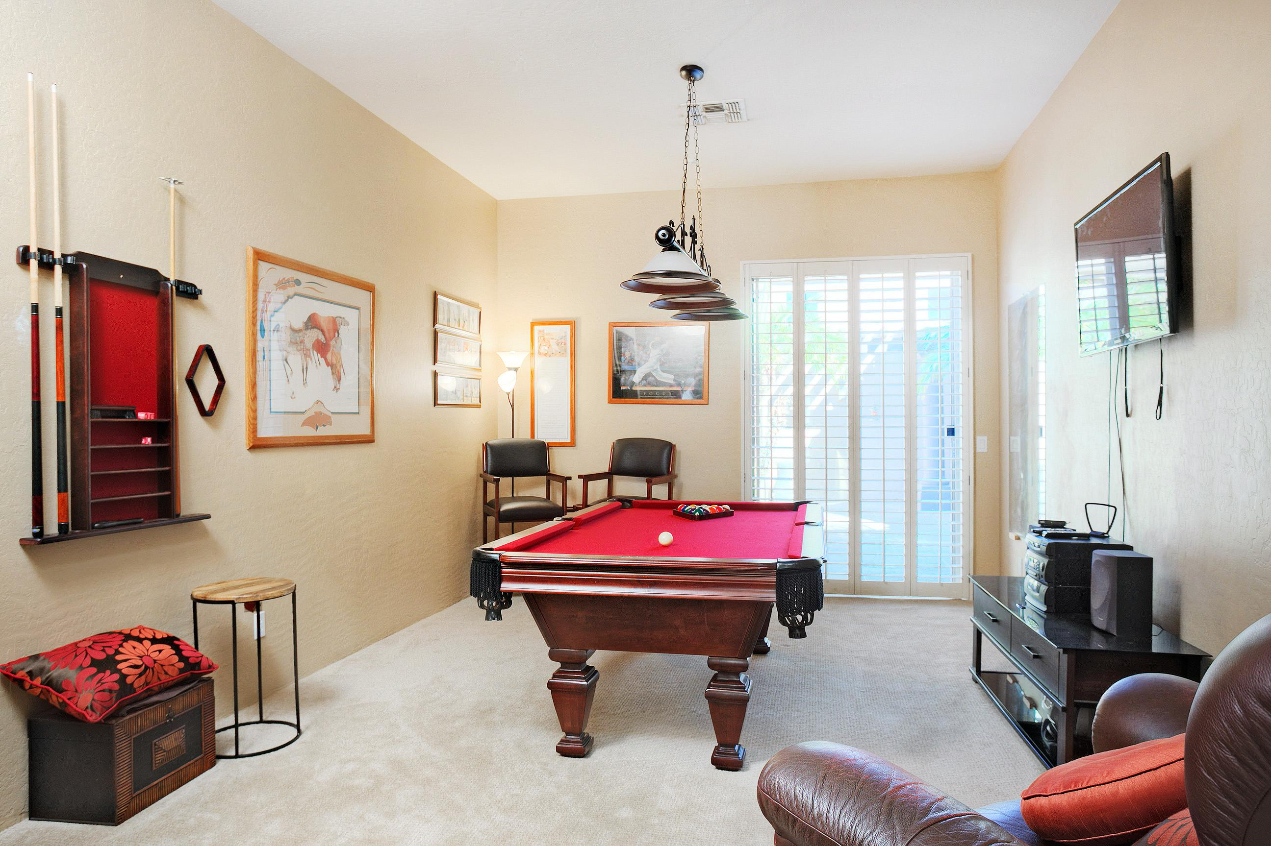 Classy game room with pool table, darts, and flat screen TV.