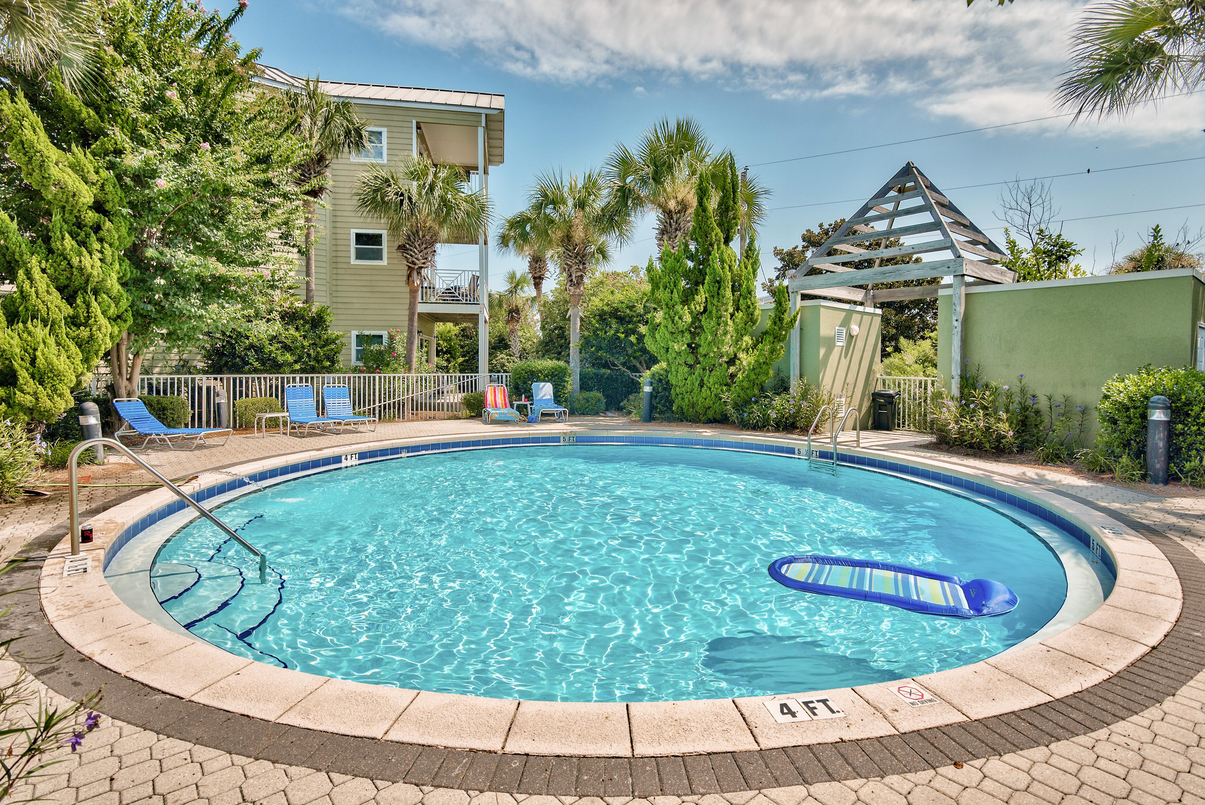 Grab a pool float and relax by the sparkling pool-- steps from your condo.