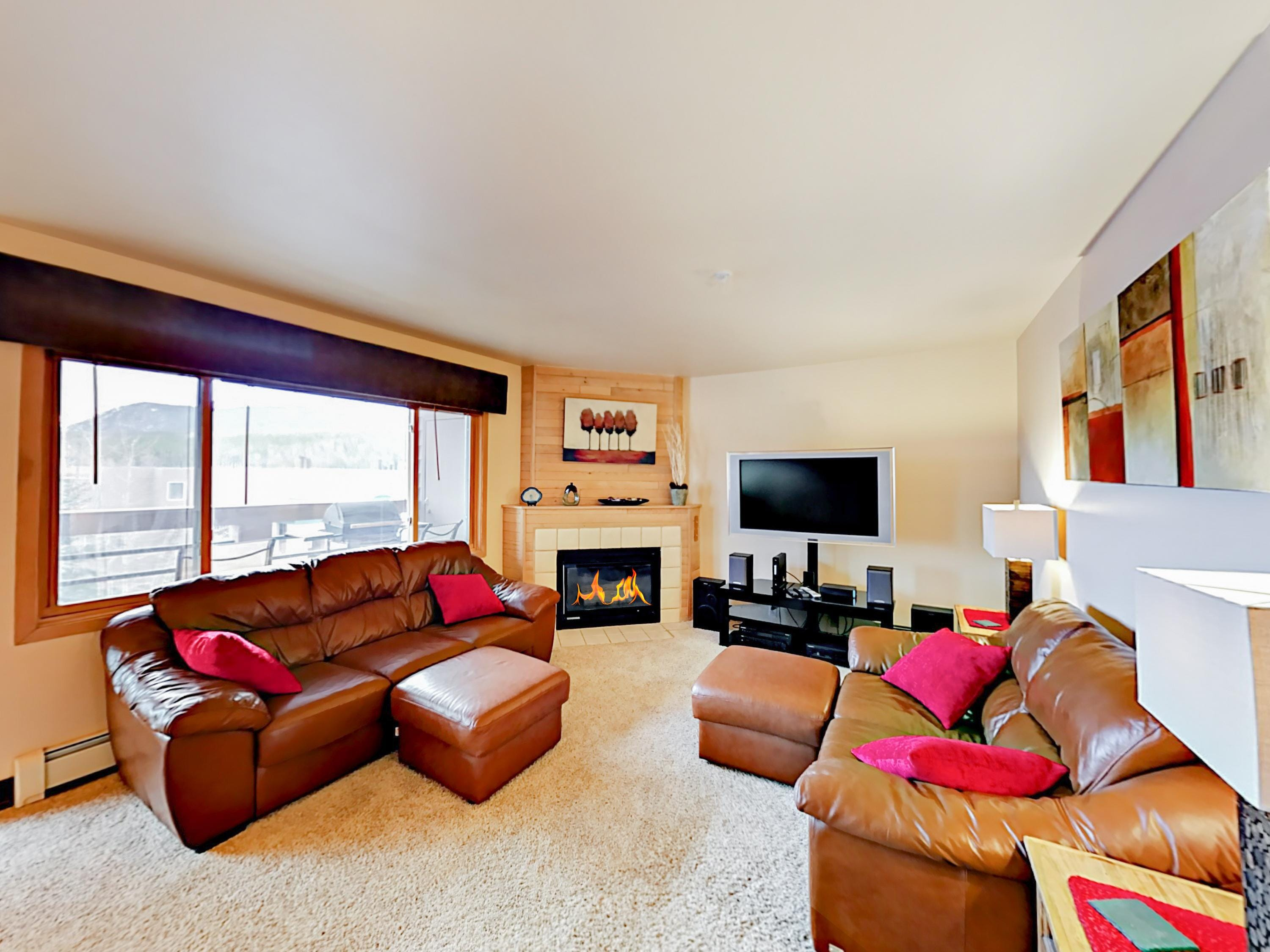 Enjoy the inviting gas fireplace and incredible views out the picture windows in the living room.