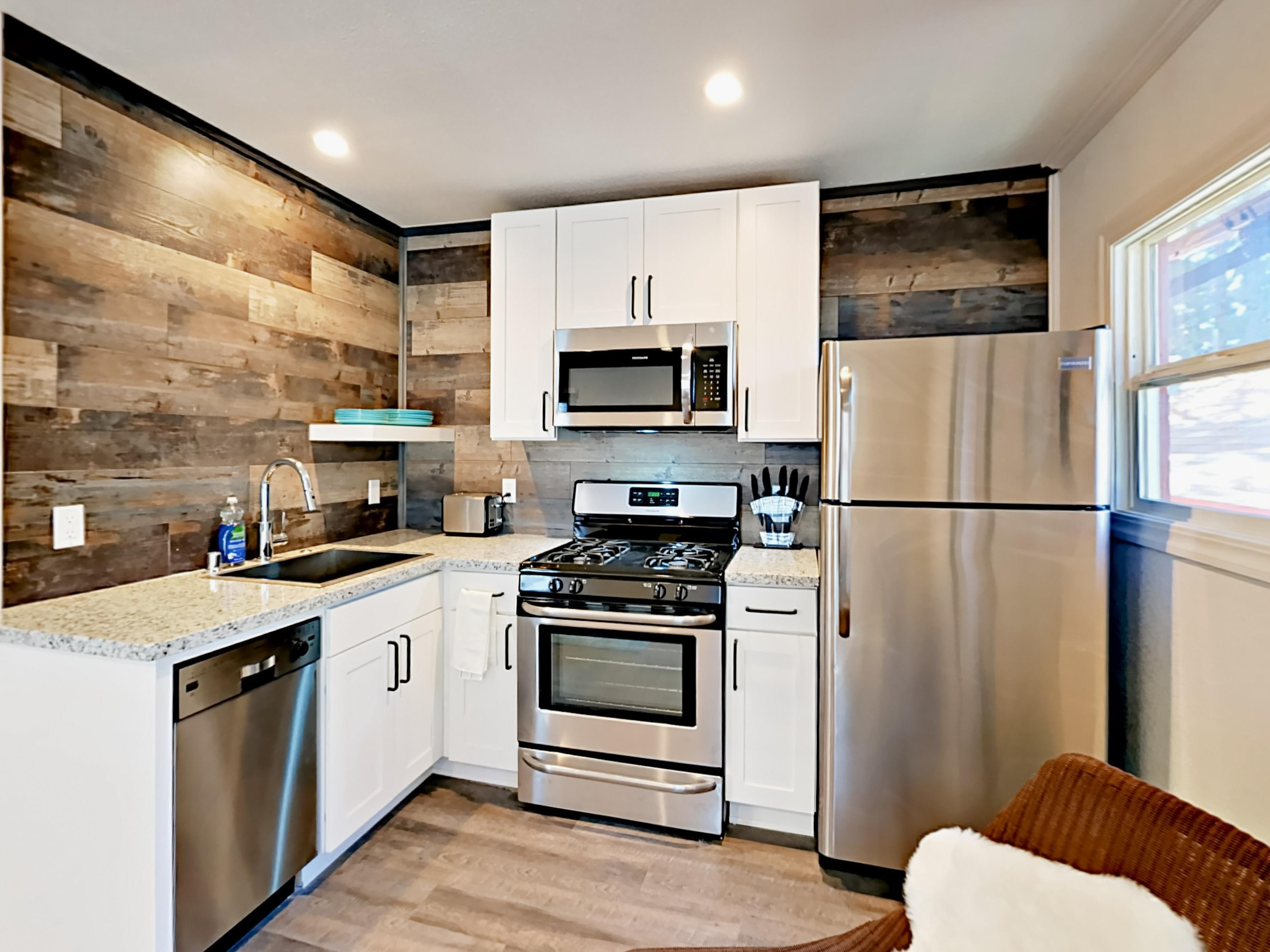 Prepare home-cooked meals in the well-equipped kitchen with granite countertops and updated stainless steel appliances.