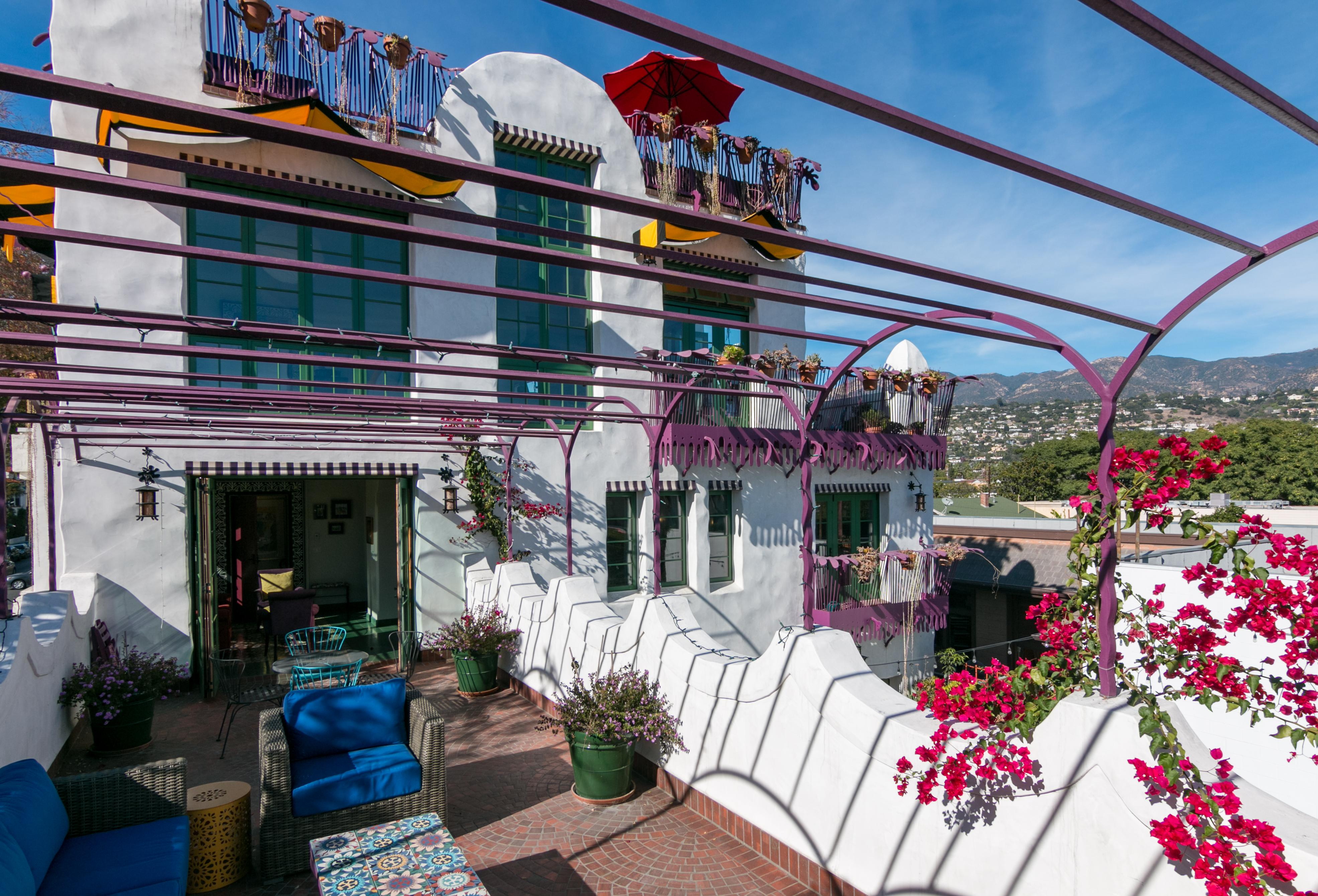 Welcome to Santa Barbara! The colorful private upstairs patio offers views of the city.