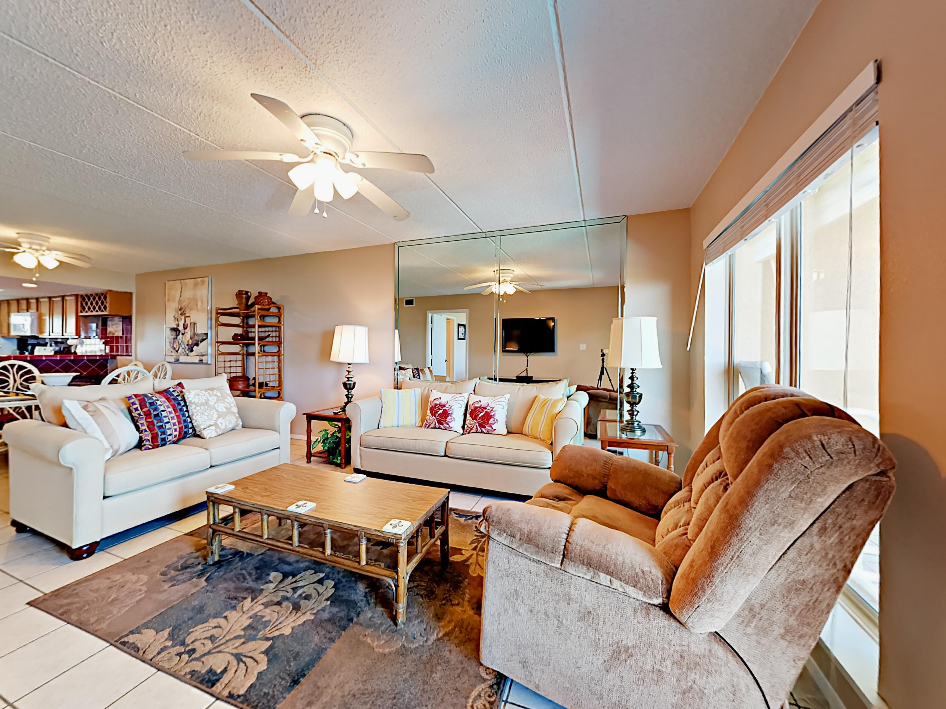 Welcome to South Padre! Plenty of comfortable seating can be found in the main living area.