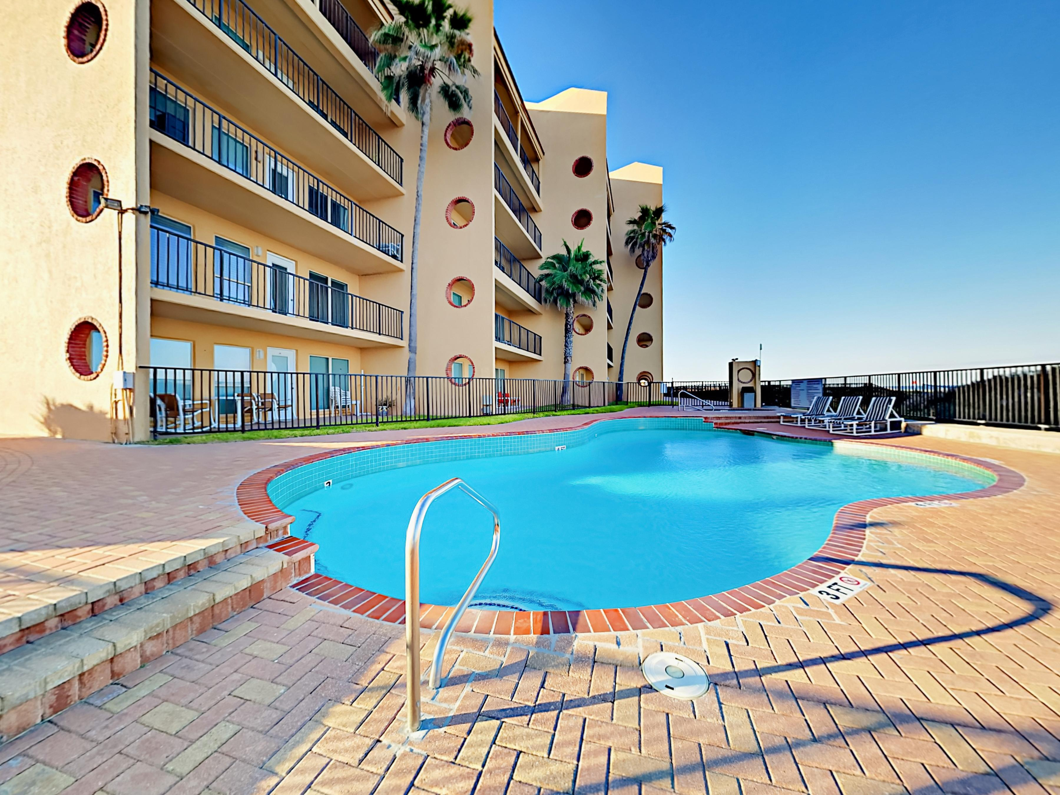 The condo complex has a large pool and relaxing hot tub overlooking the water.