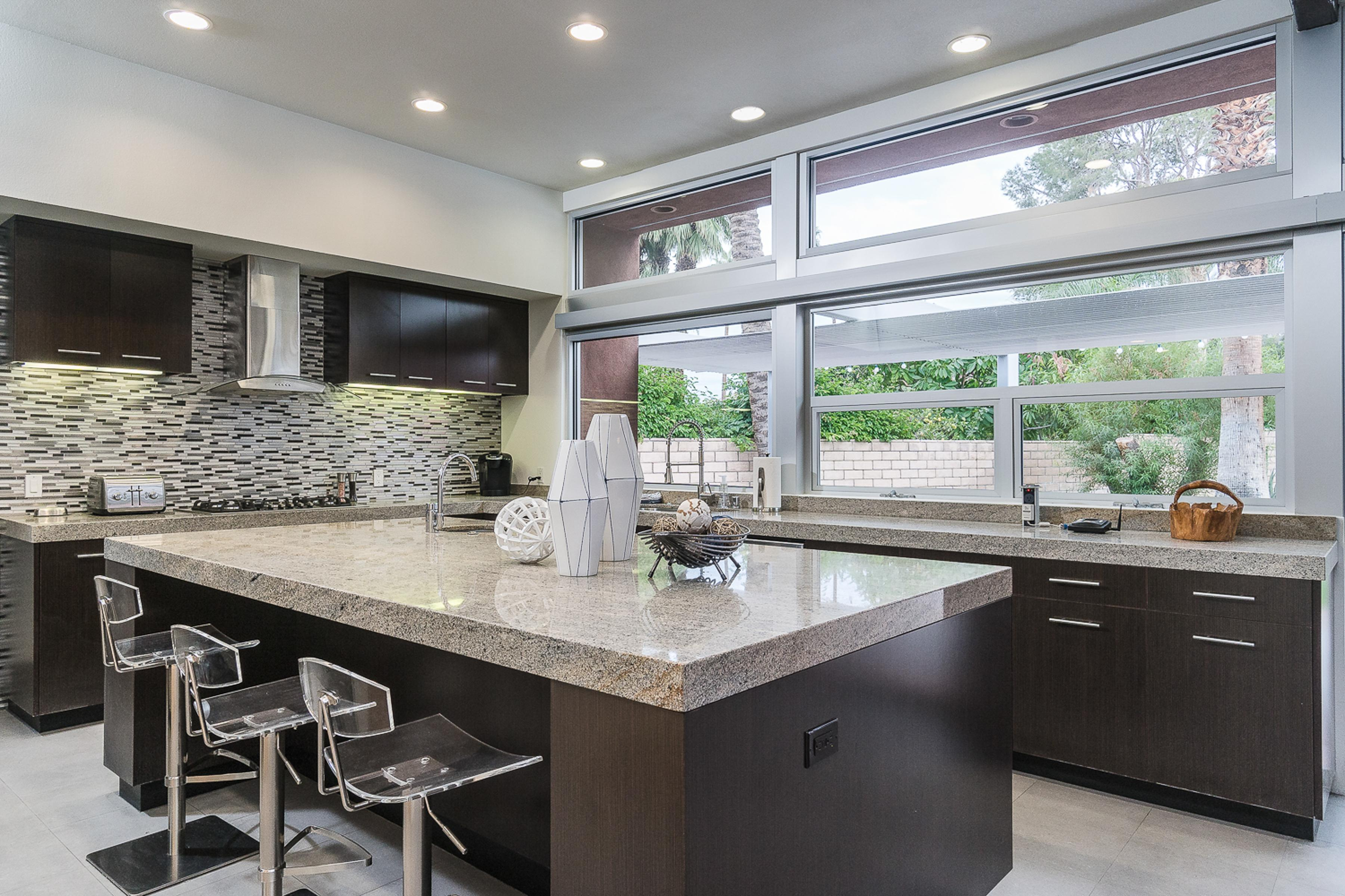 The well-stocked kitchen features high-end appliances and sleek granite counters. A starter supply of dish soap and paper towels is provided for your convenience.