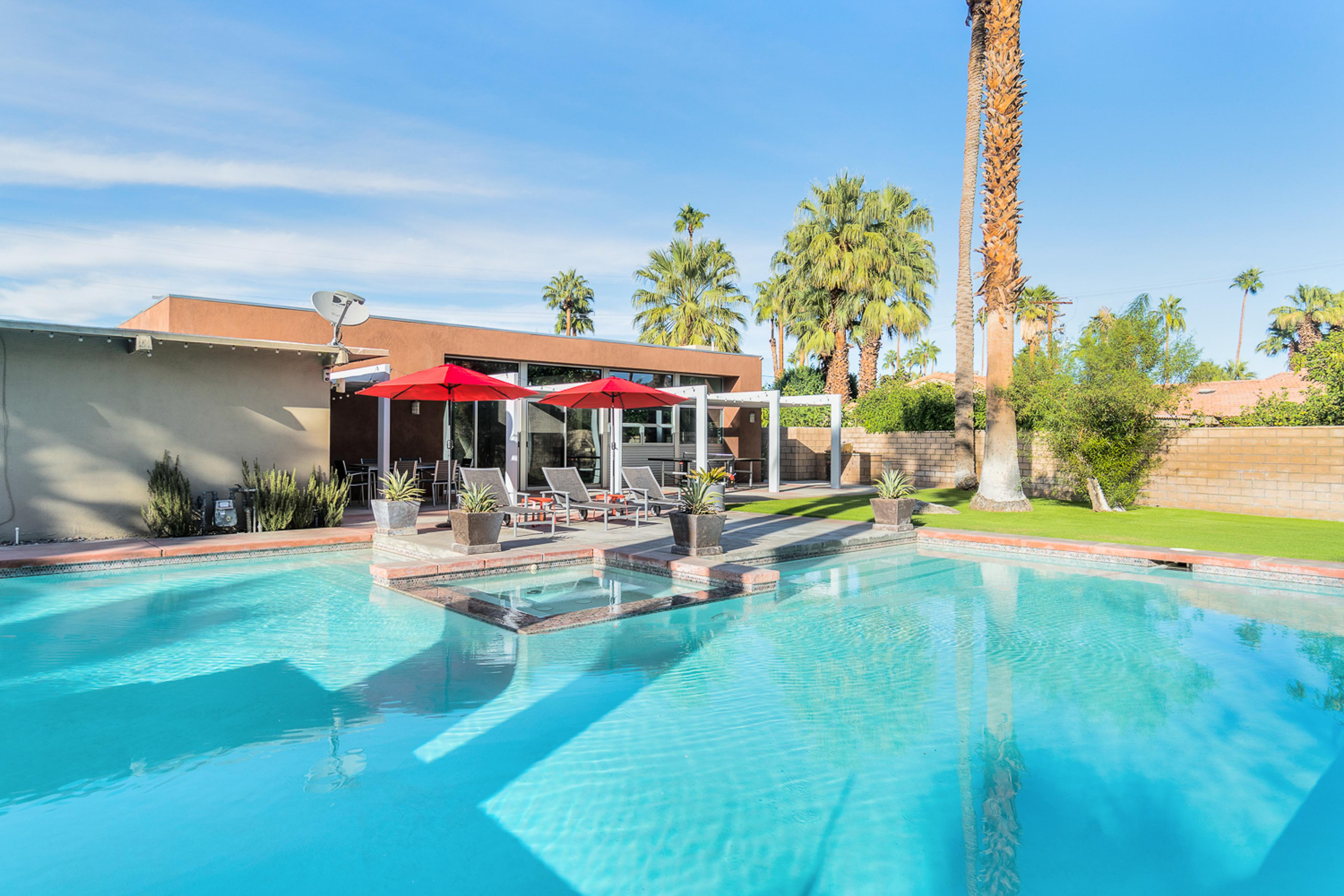 Welcome to the desert! The sunny south-facing yard features a massive resort-caliber pool with hot tub.