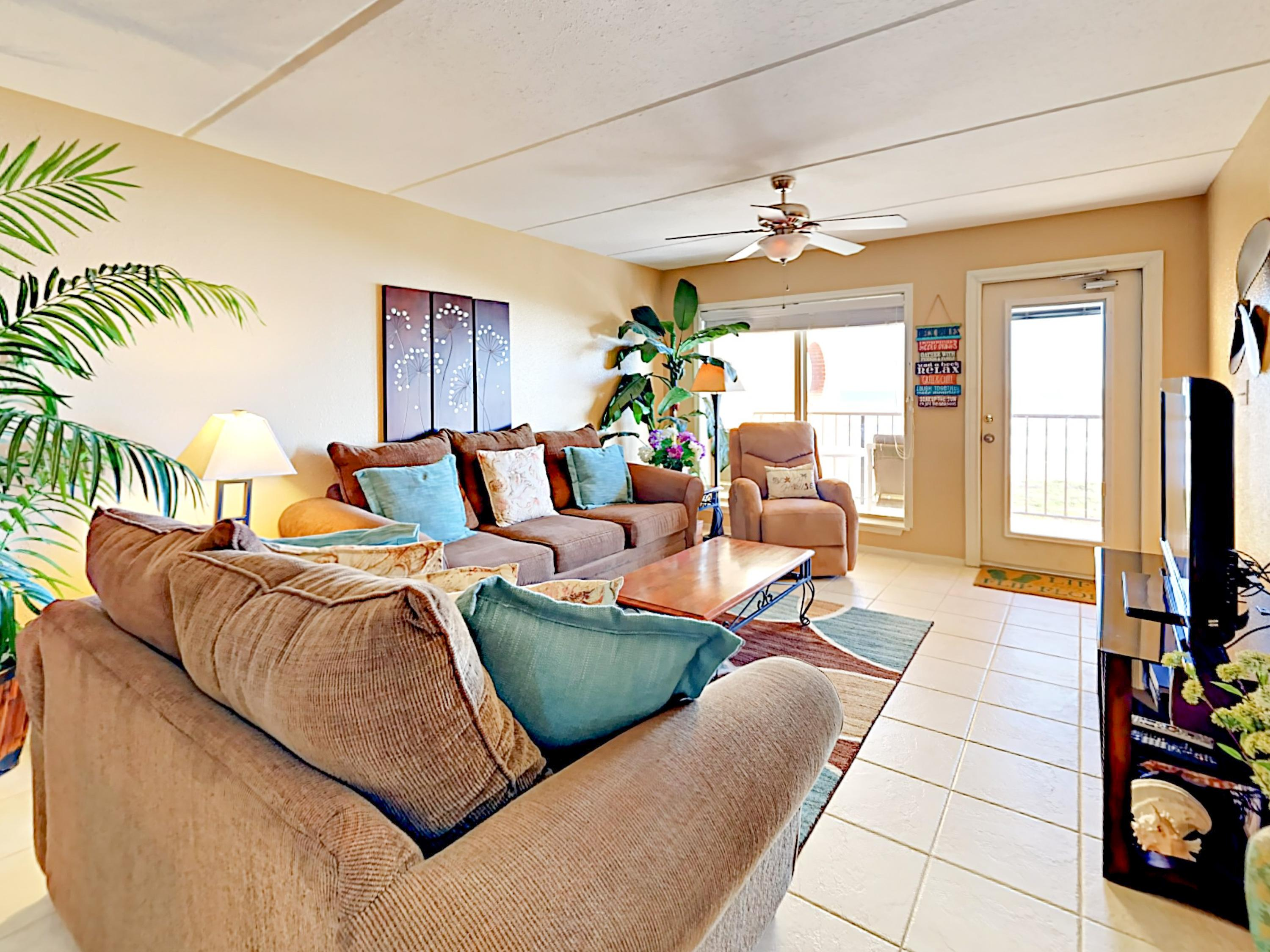Shades of sand and sea give the living room a relaxed, coastal vibe. Professional cleaning is provided by TurnKey's housekeeping staff.