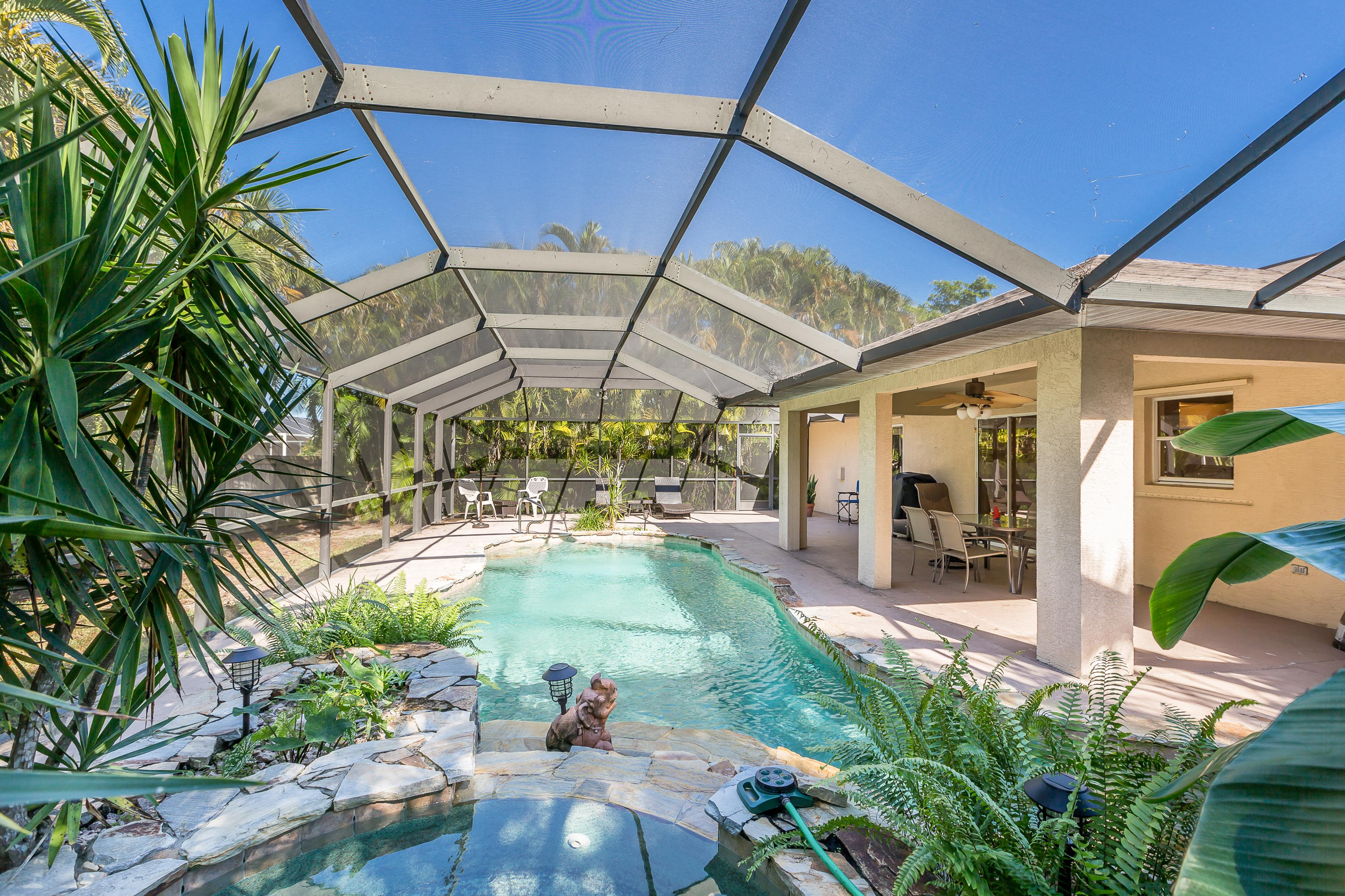 Unwind in your tropical oasis with a private heated pool, spa and dining area. This rental is professionally managed and maintained by TurnKey Vacation Rentals.