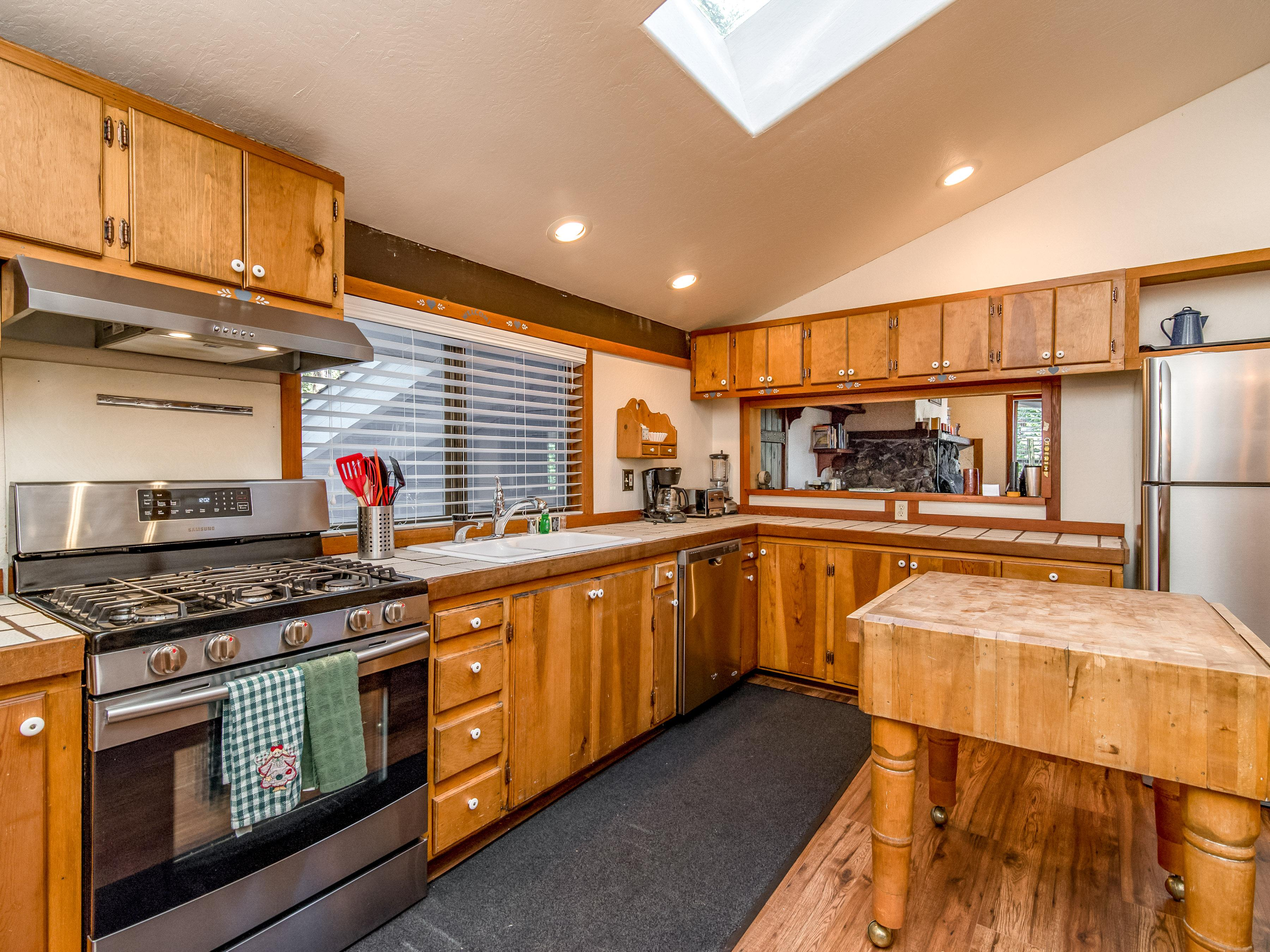 The well-equipped kitchen has stainless steel appliances, including a gas stove.