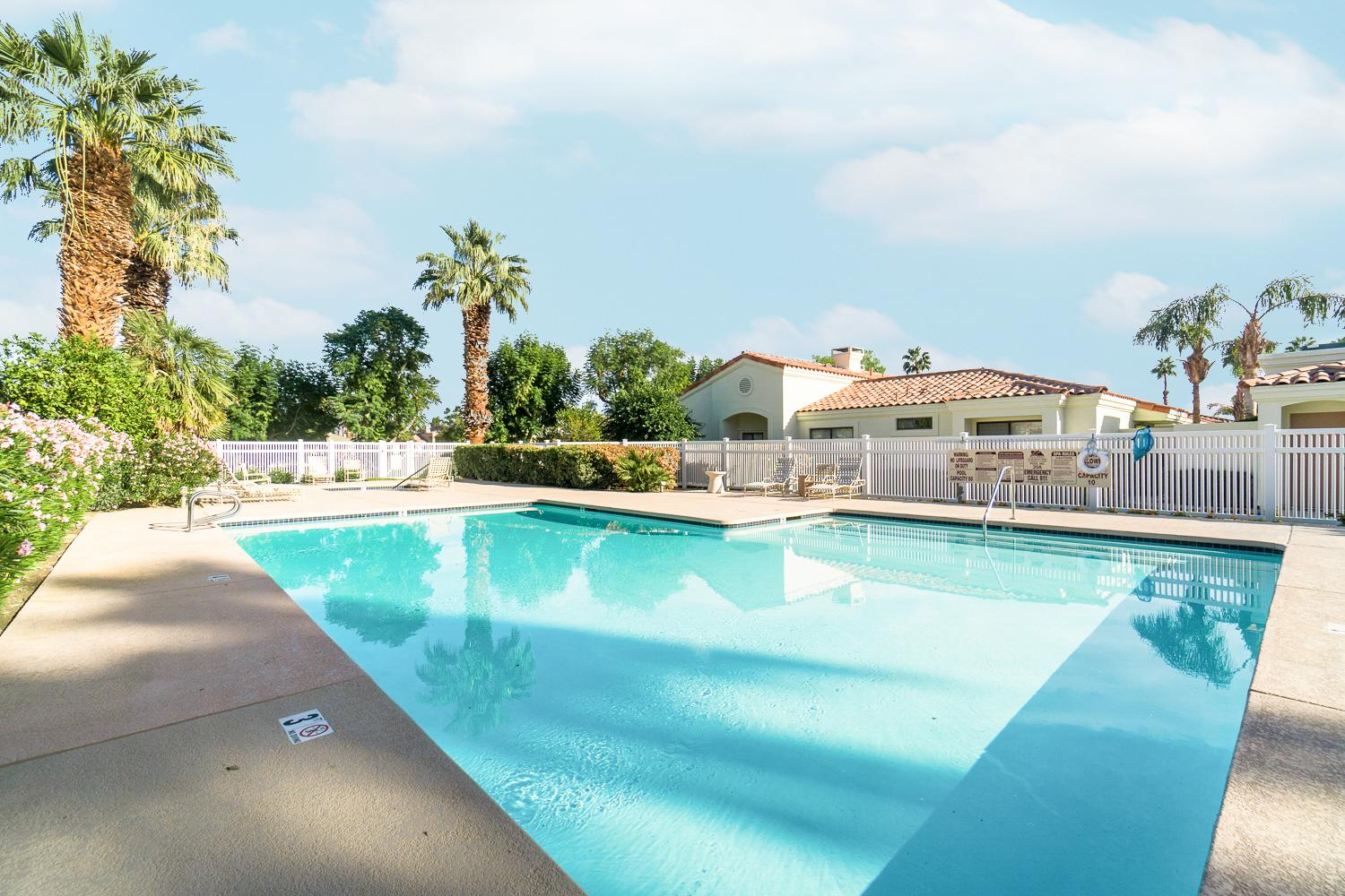Cool off in the shared pool around the corner from your townhouse.