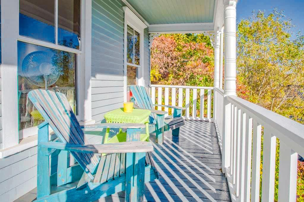 The charming front porch comes with Adirondack chairs, perfect for sipping morning coffee.