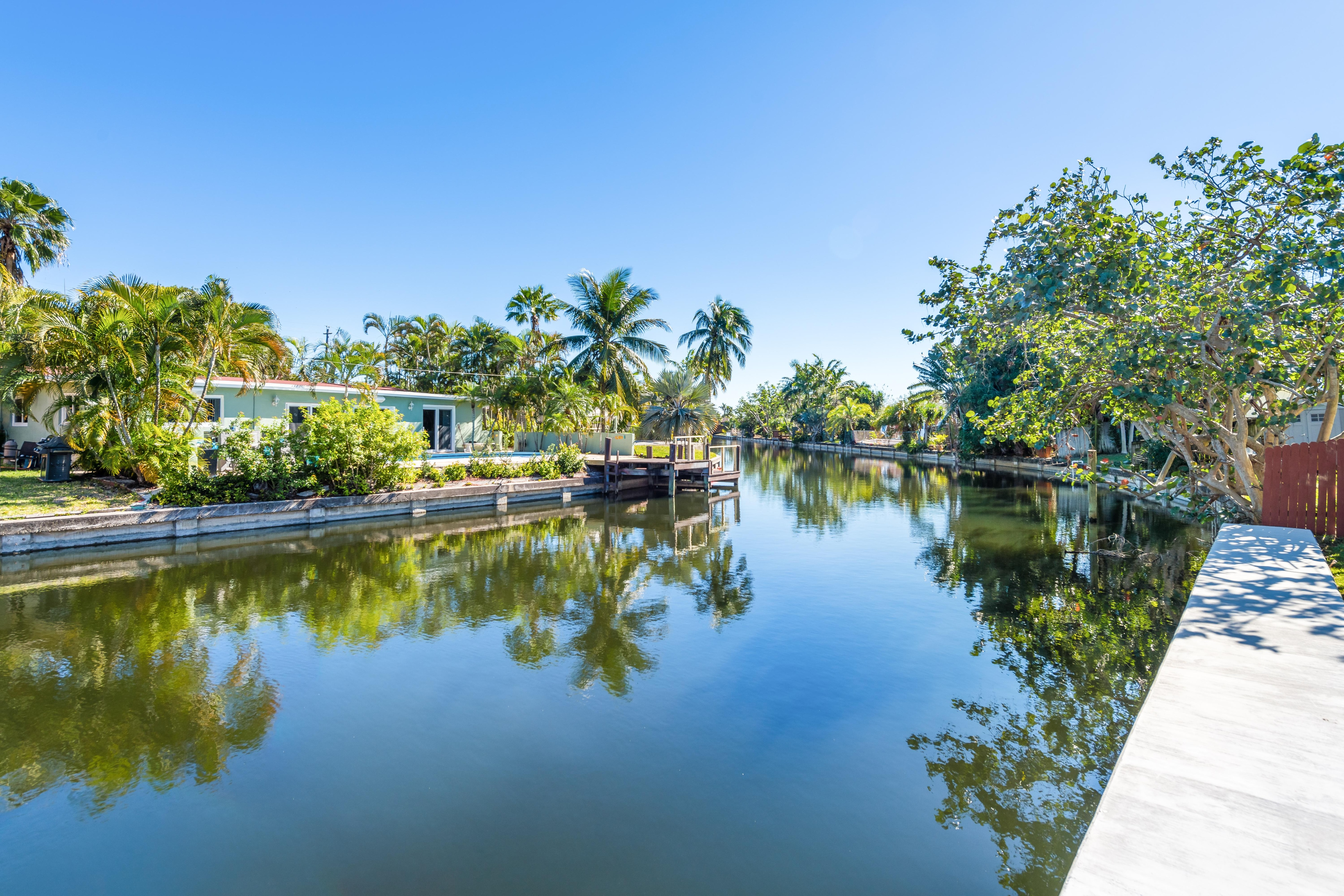 Your modern vacation home is set along the canal in sunny Oakland Park.