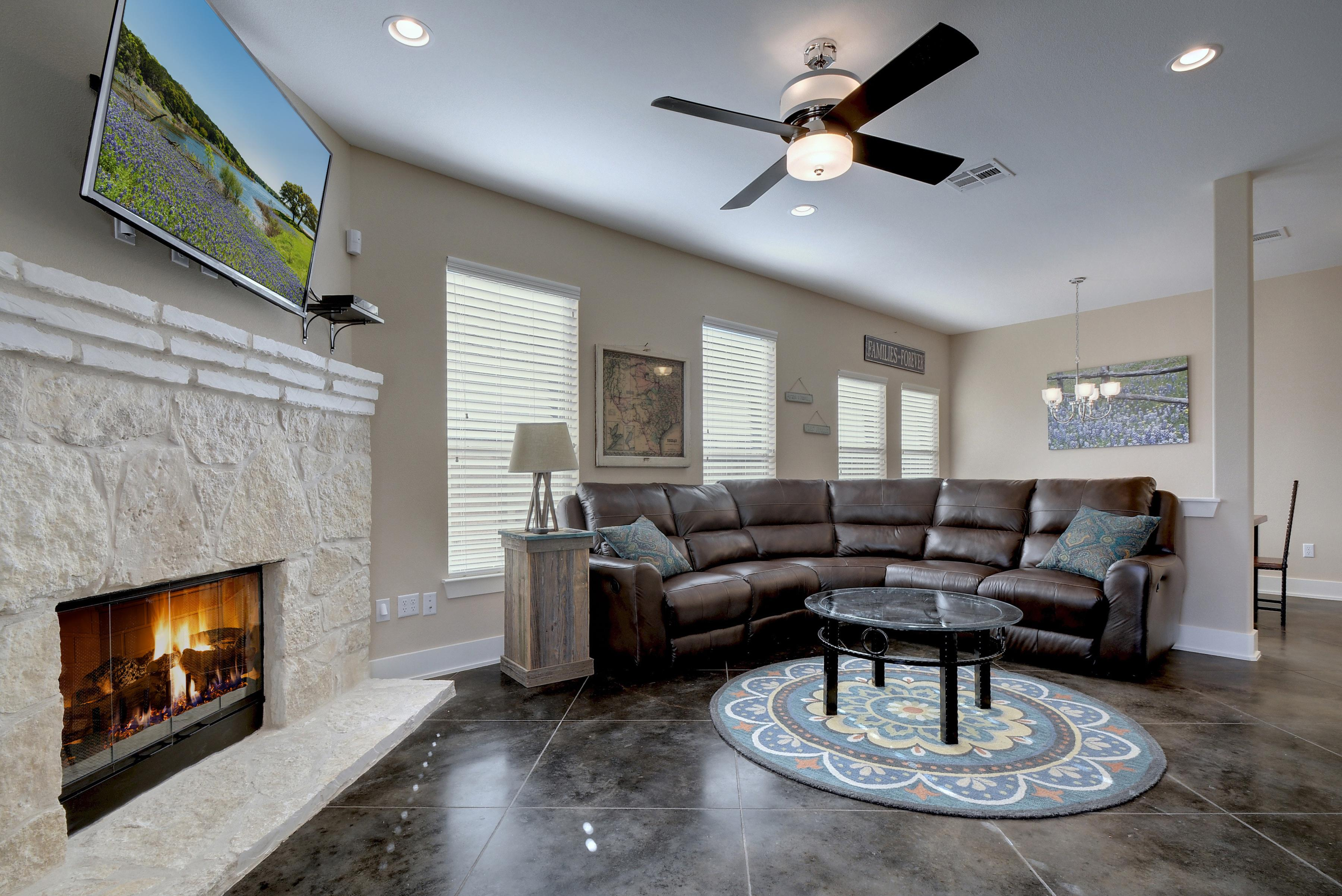 Welcome to Dripping Springs! In the main living area, a leather sofa with reclining ends creates the perfect setting to unwind.