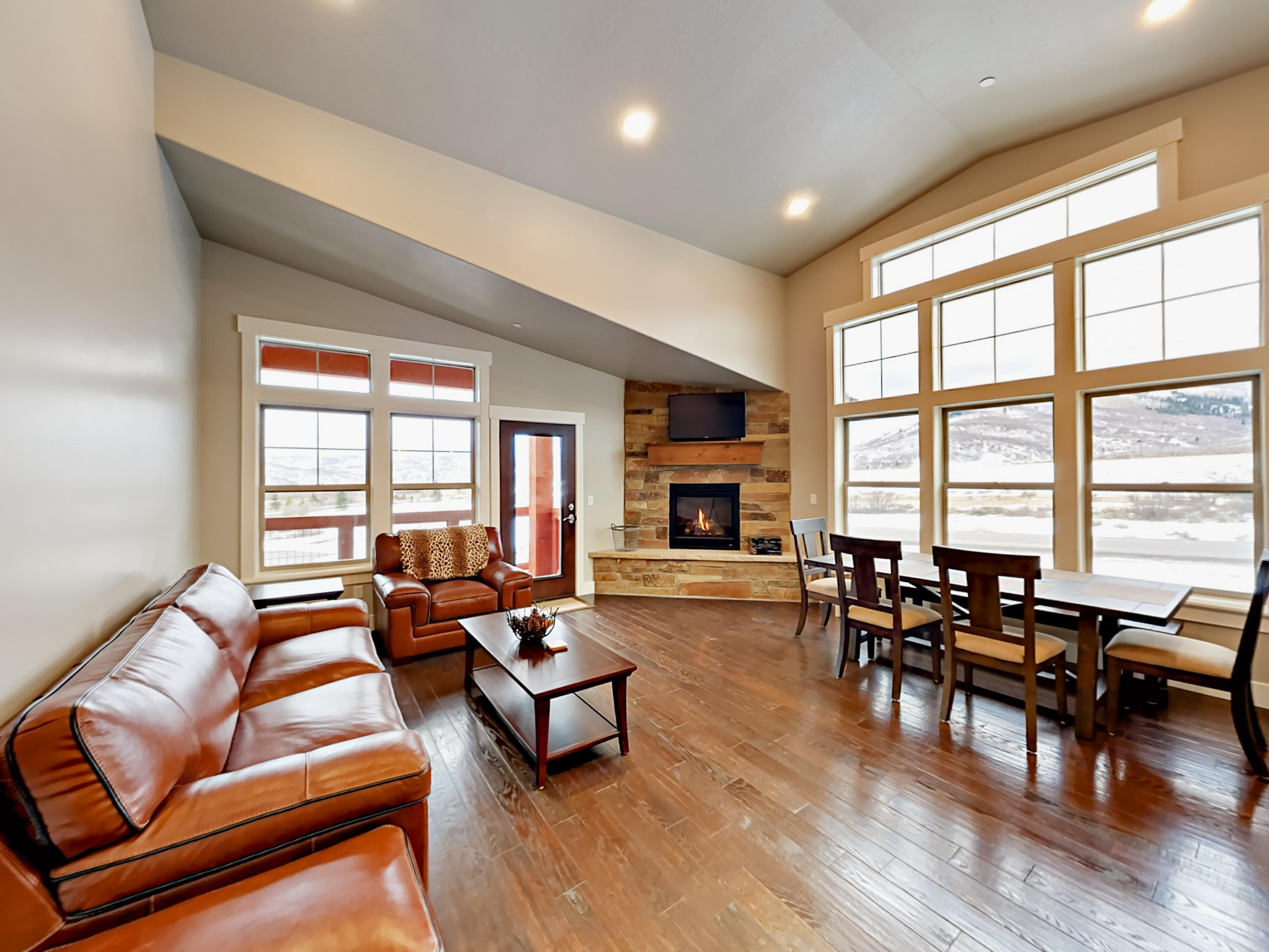 Vaulted ceilings and hardwood floors bring a contemporary feel to the open living space.