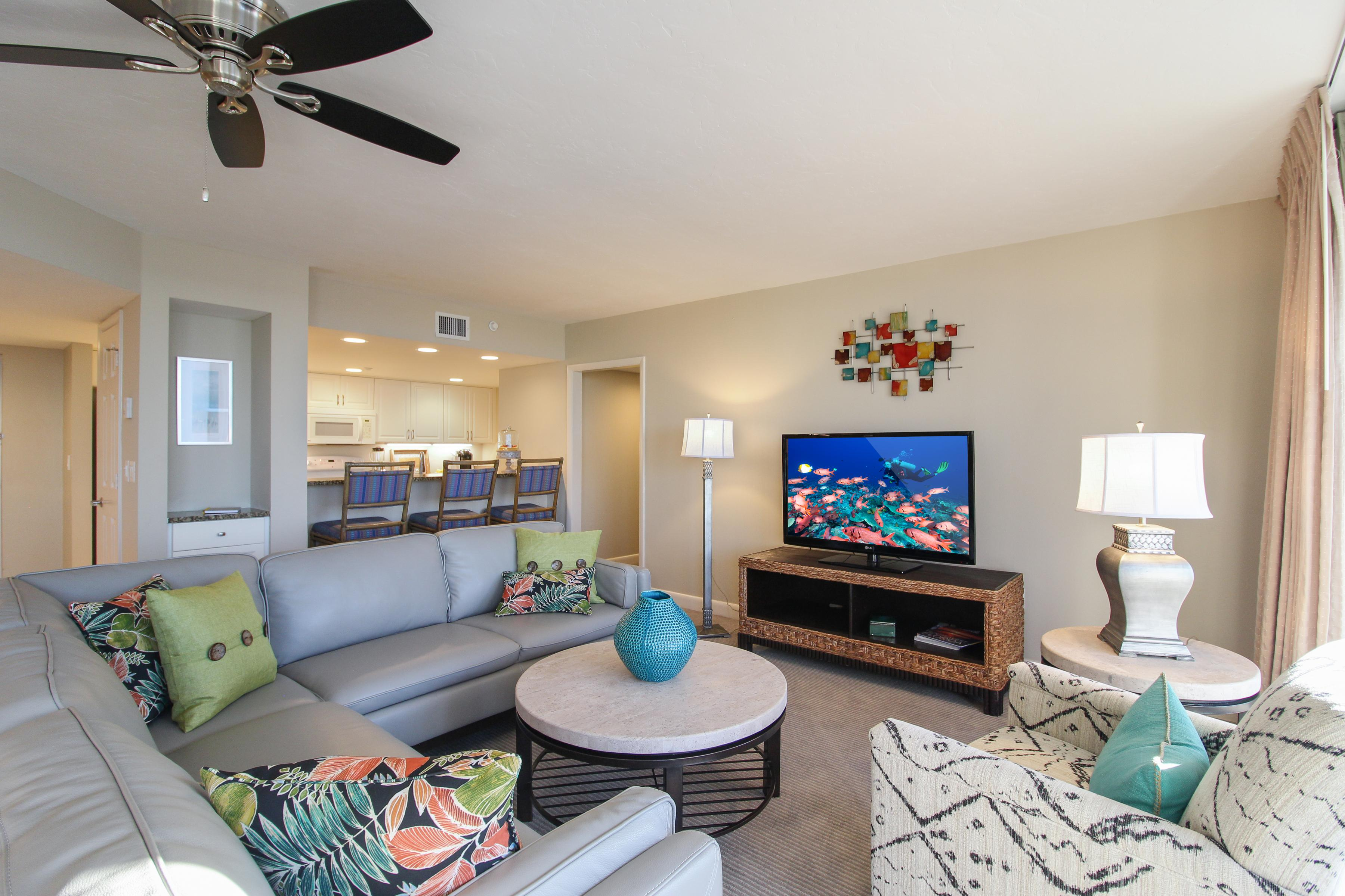 Welcome to Fort Myers Beach! Enjoy a movie night on the large flat screen TV in the living room.