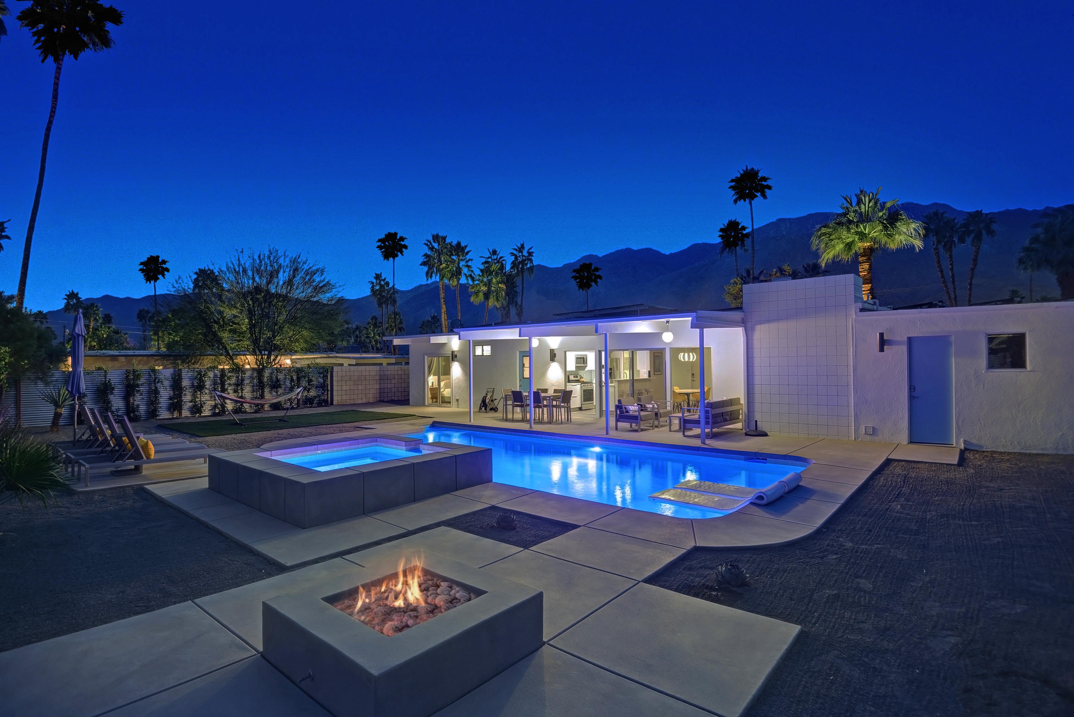 Immaculate backyard with salt water pool (multi color LED lighting included), spa, and gas fire pit. Home professionally managed and maintained by TurnKey Vacation Rentals.