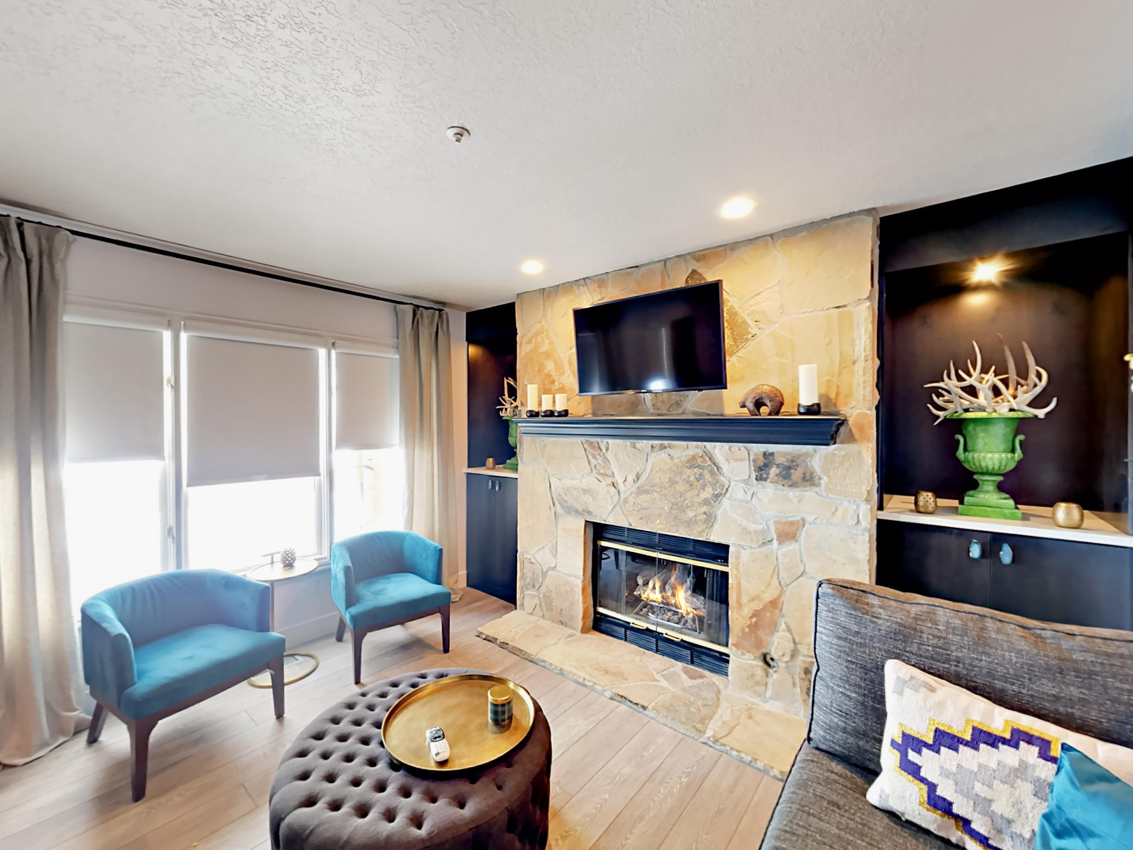 Welcome to Park City! This rental has a luxurious living room with gas fireplace, flat screen TV, and complimentary Wi-Fi.