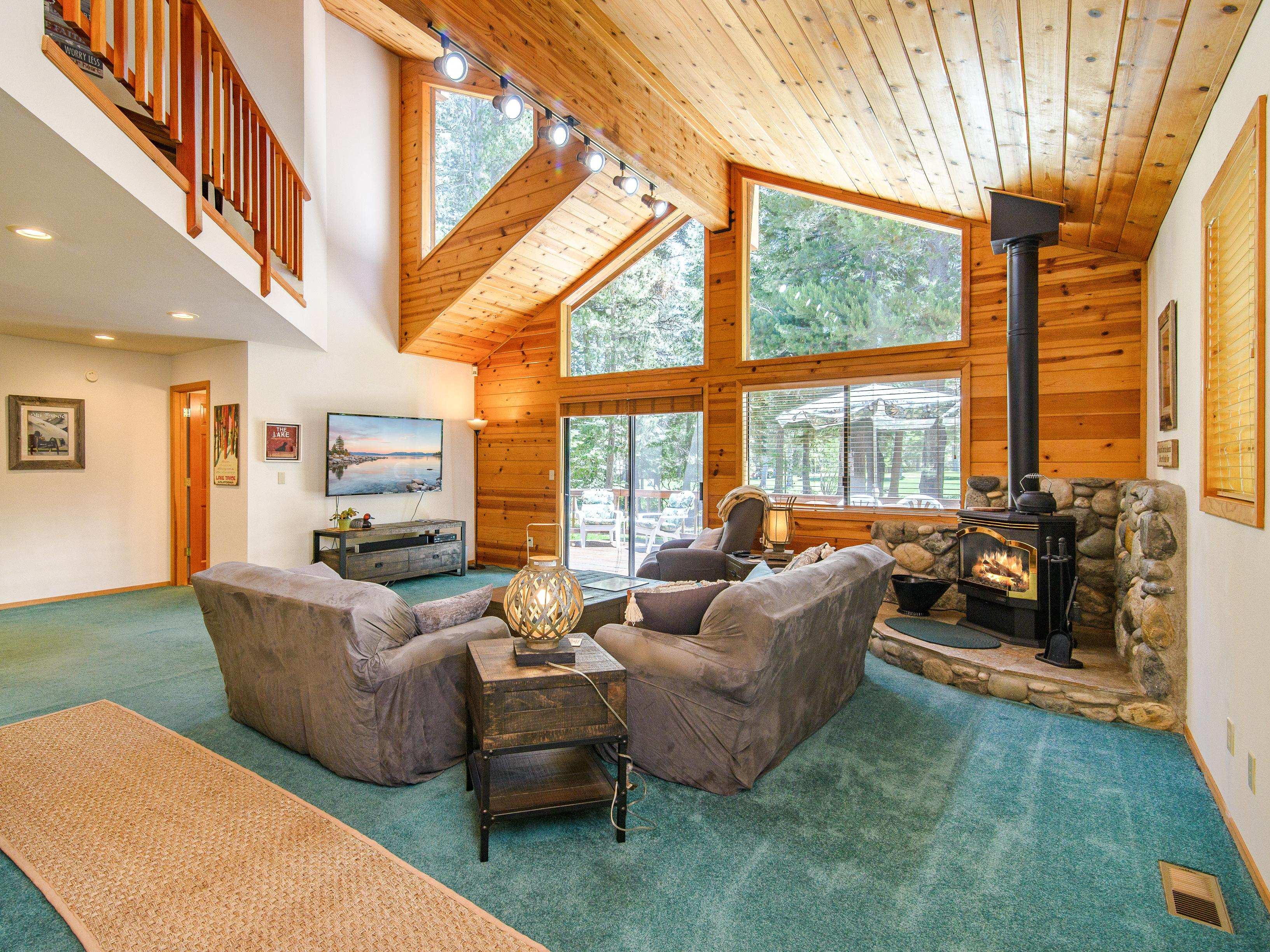 Welcome to Truckee! Vaulted ceilings soar in the living room, where a gas fireplace sits centerstage.